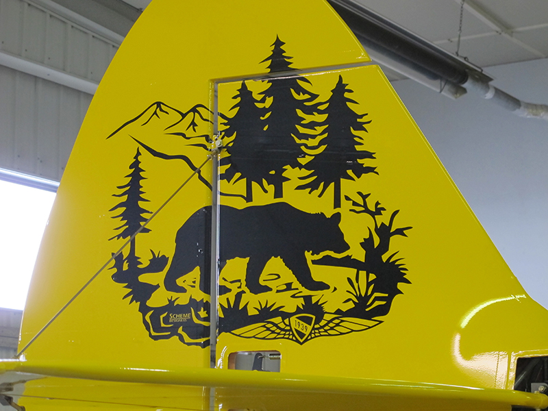 The Super Cub's tail art gives a nod to the aircraft's backcountry prowess, with a bear cub, lake, and mountain scene. We'll be giving the aircraft away with tundra tires, amphibious floats, and hydraulic skis. Photo by Alyssa J. Cobb.