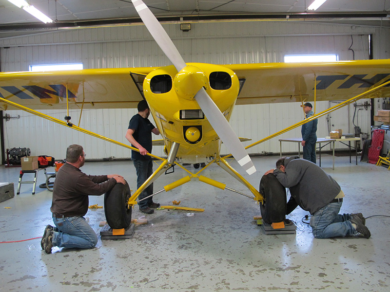 Bake Air Service prepares to get the Super Cub's empty weight.