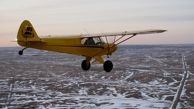 The Sweepstakes Super Cub flies over snowy eastern Montana during its second test flight on April 6.