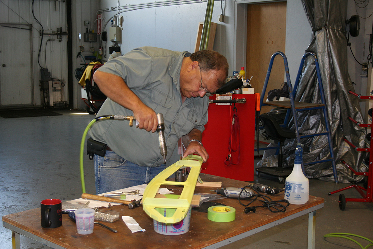 Baker Air Service Owner Roger Meggers modifies one of the wing ribs for the Wipaire 2,000-pound gross-weight increase kit.