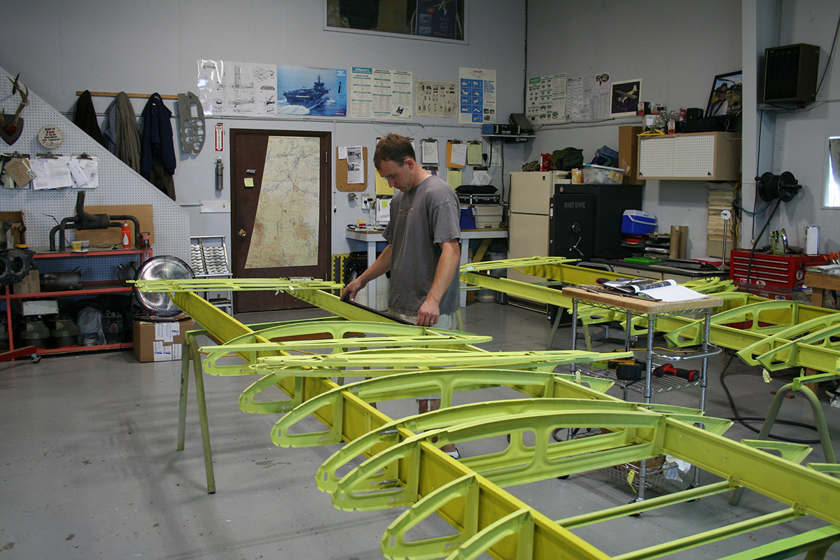Baker Air Service's Darin Meggers works on the Wipaire 2,000-pound gross-weight increase kit.