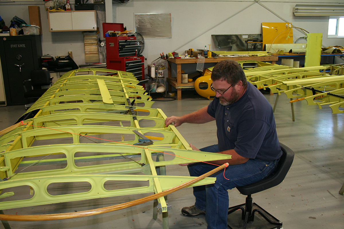 Baker Air Service's John Anderson fits the aileron false spars.