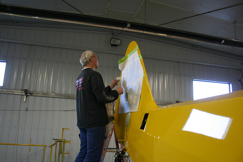 The Sweepstakes Super Cub's unique tail art will soon be added to N954PC, thanks to detailing expert Don Buerkle.