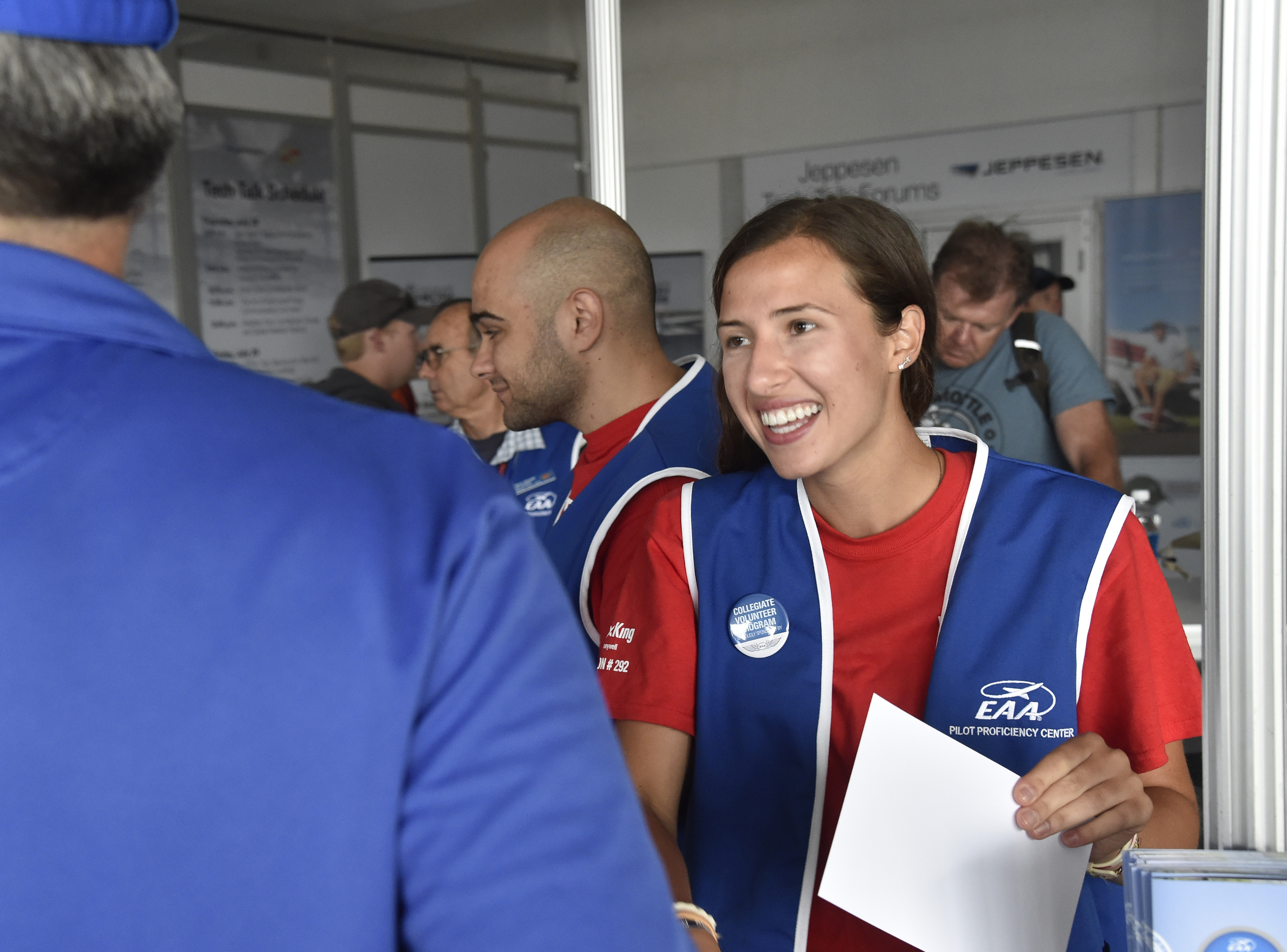 Private pilot Christine Oksas helps EAA AirVenture attendees at the Pilot Proficiency Center in Oshkosh July 29. Photo by David Tulis.