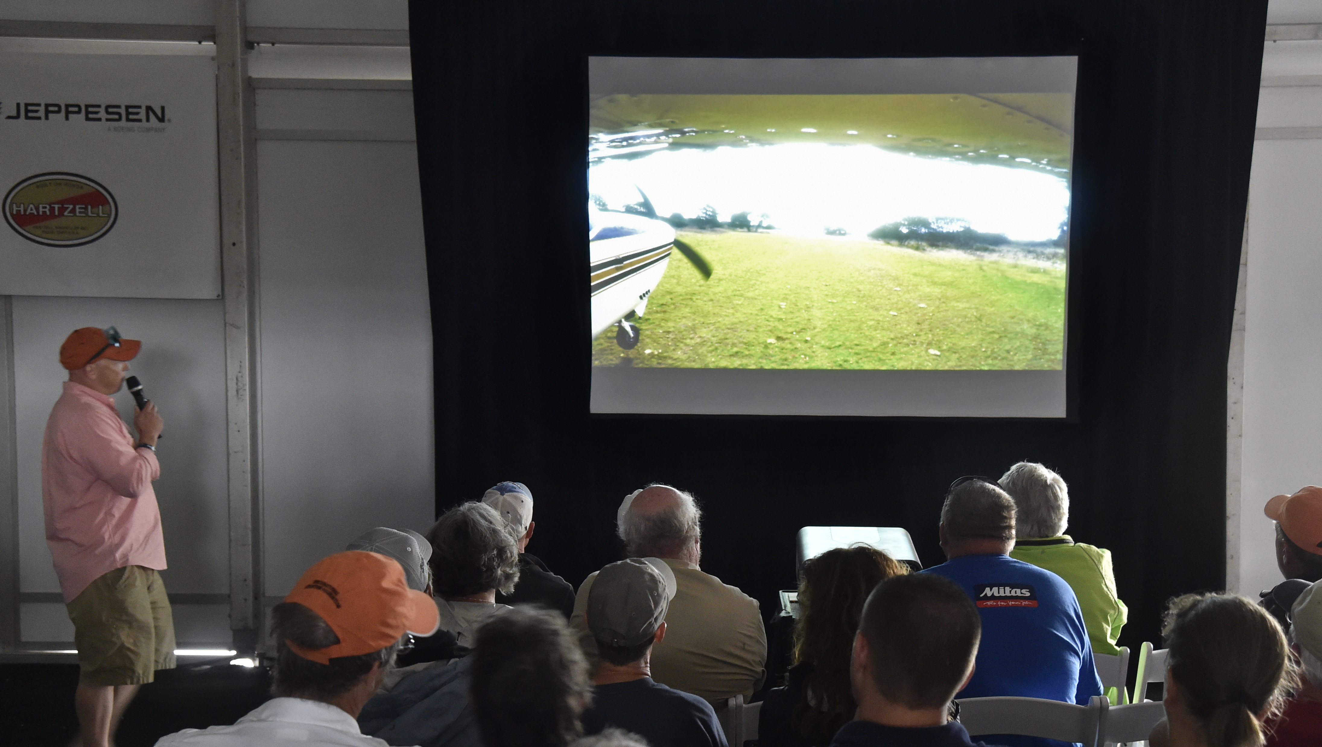 Pilots watch a Tech Talk presentation at EAA AirVenture's Pilot Proficiency Center. Jack Pelton, EAA CEO and chairman, said the association met its goal of 5,000 pilots passing through the learning facility. Photo by David Tulis.
