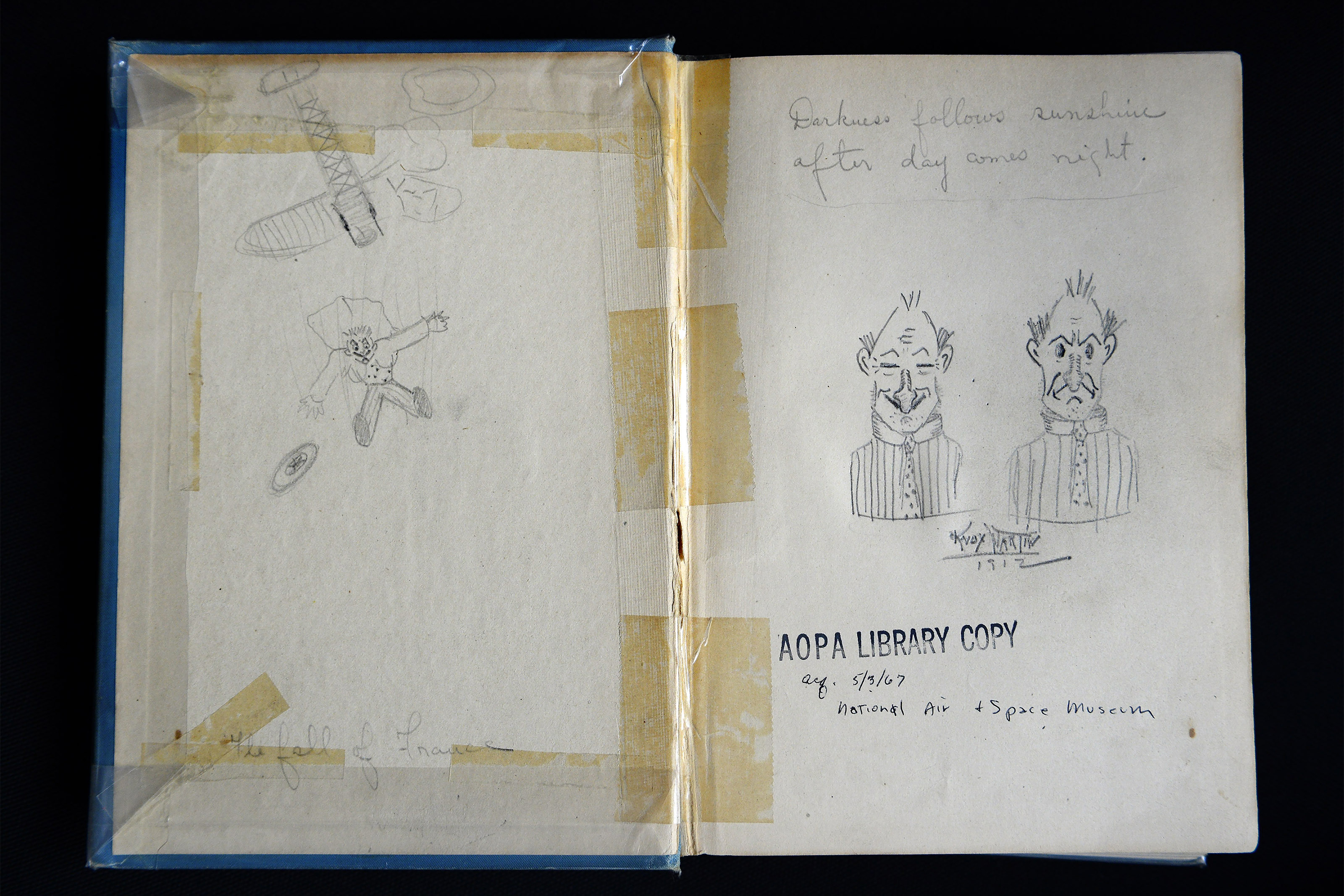 Aviation pioneer Knox Martin, who established air routes in South America during the 1910s and 1920s, had doodled in a long lost book that was delivered to his son, artist Knox Martin, by AOPA's Dave Hirschman, Dec. 4. Photo by David Tulis.