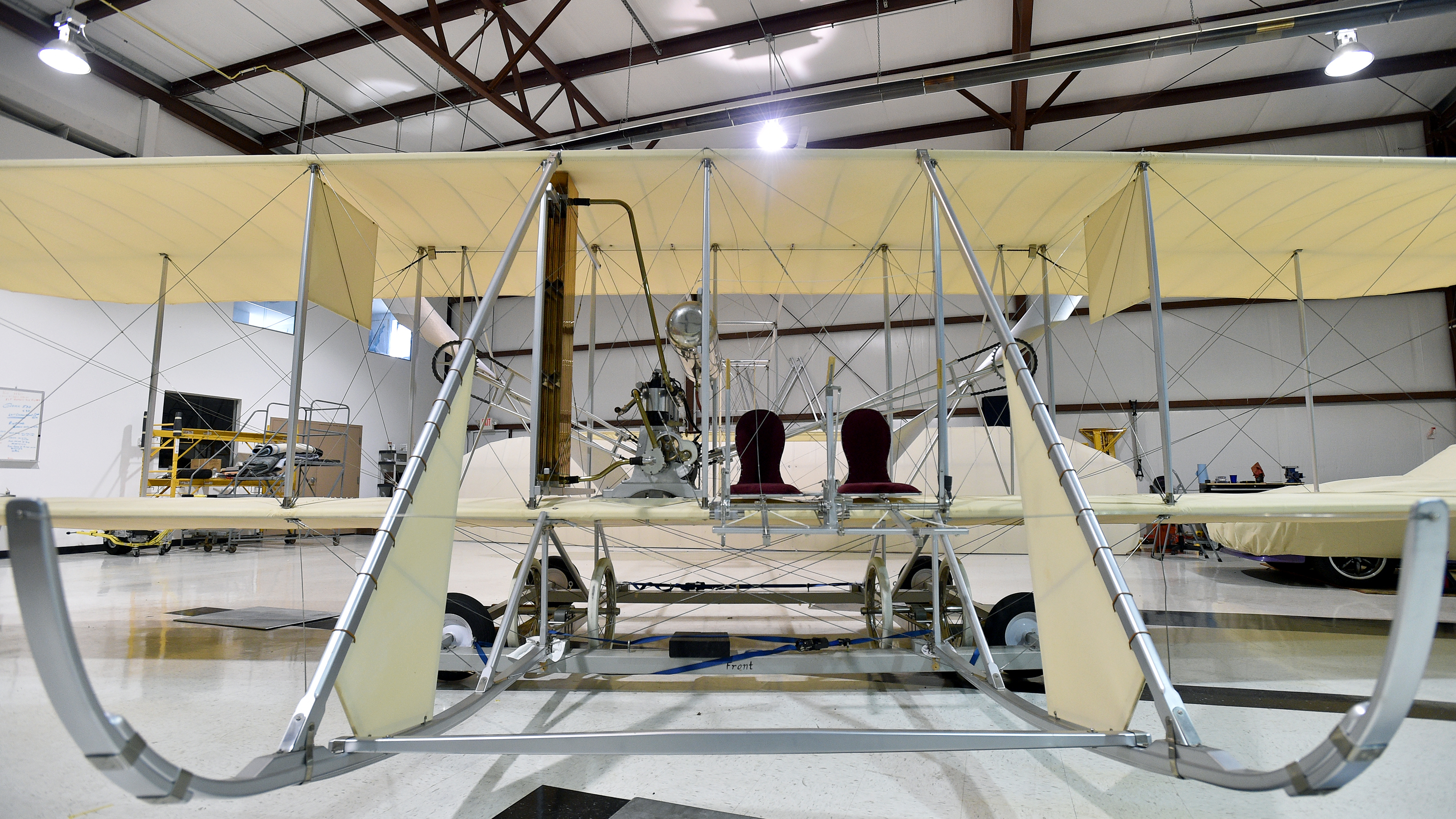 A 1911 Wright Flyer B re-creation shows the ingenuity the Wright brothers deployed to design and build their flying machine. The pilot sits to the outside and a student sits inside, next to the engine. Photo by David Tulis.