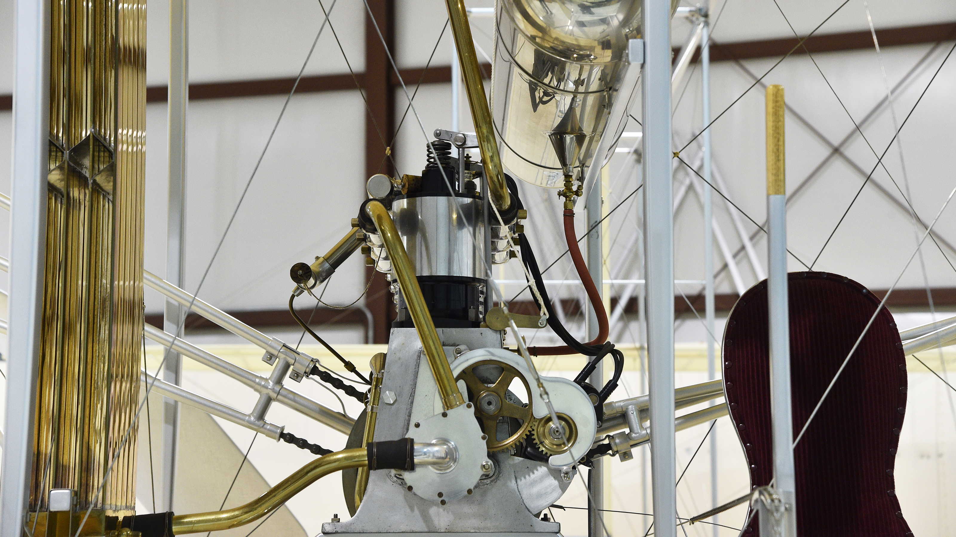 Silver paint helps disguise a wing strut and its attachment fittings on a 1911 Wright Flyer Model B aircraft re-created by The Wright Experience's Ken Hyde and team. Photo by David Tulis.