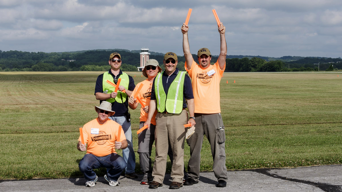 Volunteers made safe, efficient operations possible, and this crew took time out to show some pride during the 2015 AOPA Fly-In at the association's home in Frederick, Maryland.