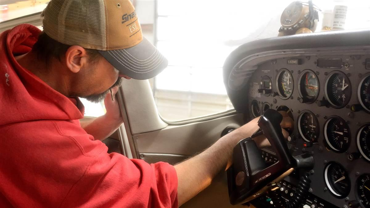 Lancaster Avionics technician Scott Kuhns installs a FreeFlight Systems UAT control head in a Cessna 172. The UAT will provide both ADS-B Out and In capabilities. Photo by Mike Collins.