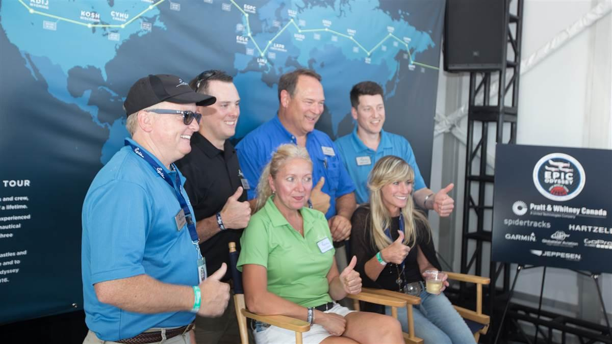 Epic CEO Doug King, at far left, and his staff celebrate the completion of the journey around the world at EAA AirVenture July 26. Photo by Jim Moore.
