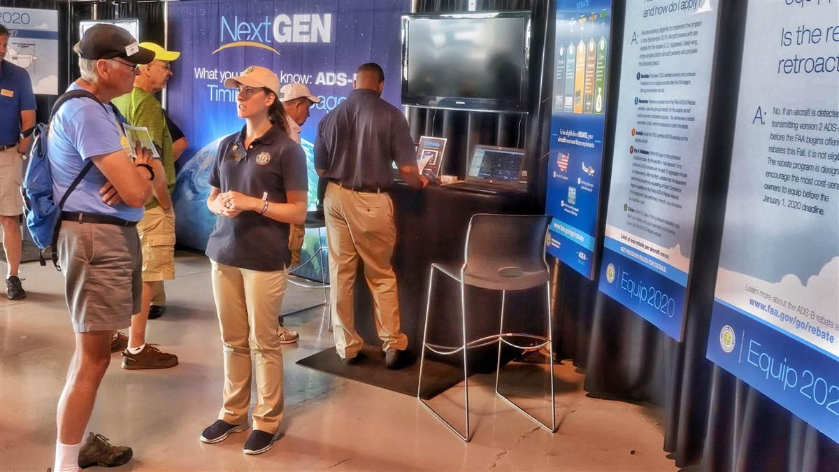 Pilots visit the FAA's NextGen and ADS-B exhibit at EAA AirVenture 2016. Interest in the new technology, required to fly in airspace where a transponder is mandated today beginning in January 2020, is higher than ever. Photo by Mike Collins.