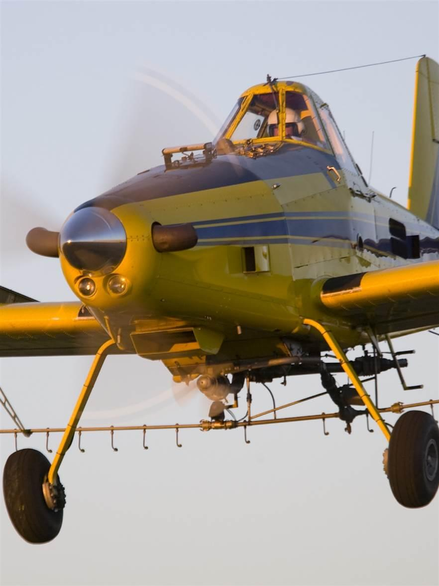 An Air Tractor makes a pass in this AOPA file photo. The company recognizes that technology developed for drones may one day allow the pilot and seat to be removed from aircraft like this.