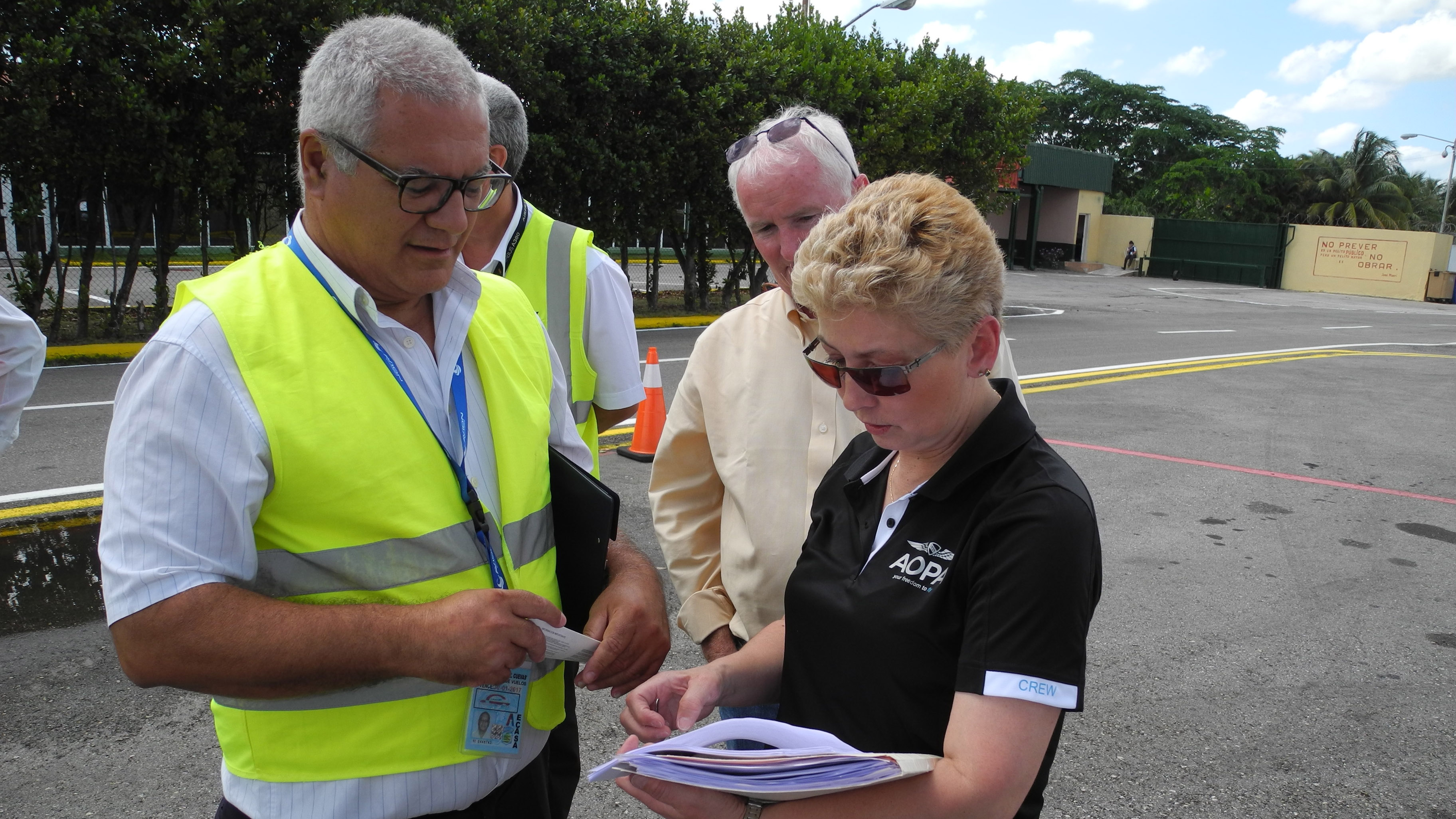 Processing into and out of Cuba is a multi-step effort, as AOPA corporate pilot Luz Beattie, a native Spanish speaker, and AOPA President Mark Baker learn in Havana.