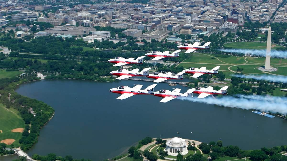 The Canadian Snowbirds aerial demonstration team performs a nine-ship friendship flyover of Washington, D.C. in their CT-114 Tutor jet aircraft before landing at Washington Dulles International Airport May 24. Photo courtesy of the Canada Department of National Defence.