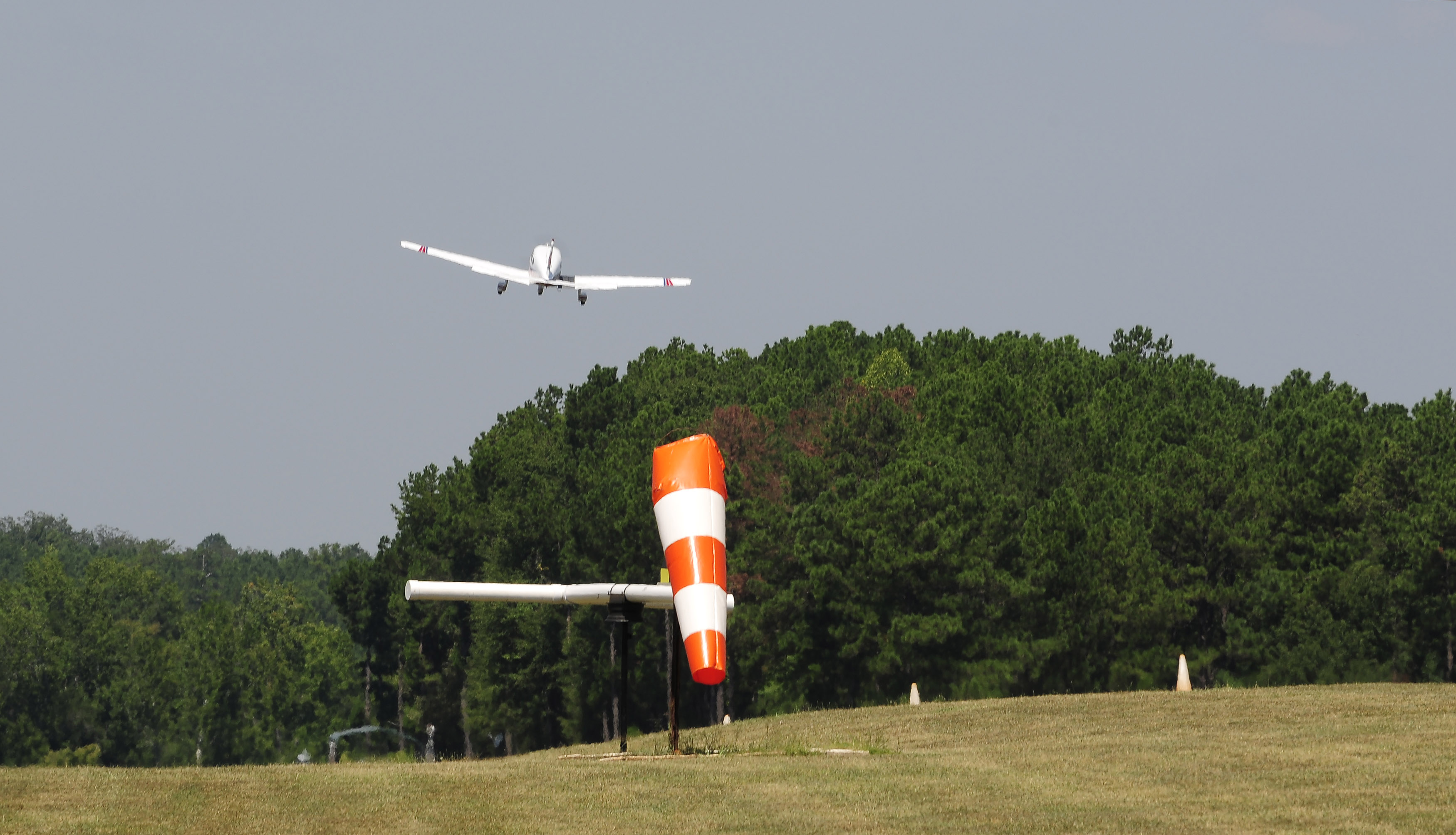 An aircraft takes off from Peach State Aerodrome's grass strip in Williamson, Georgia. Photo by David Tulis.