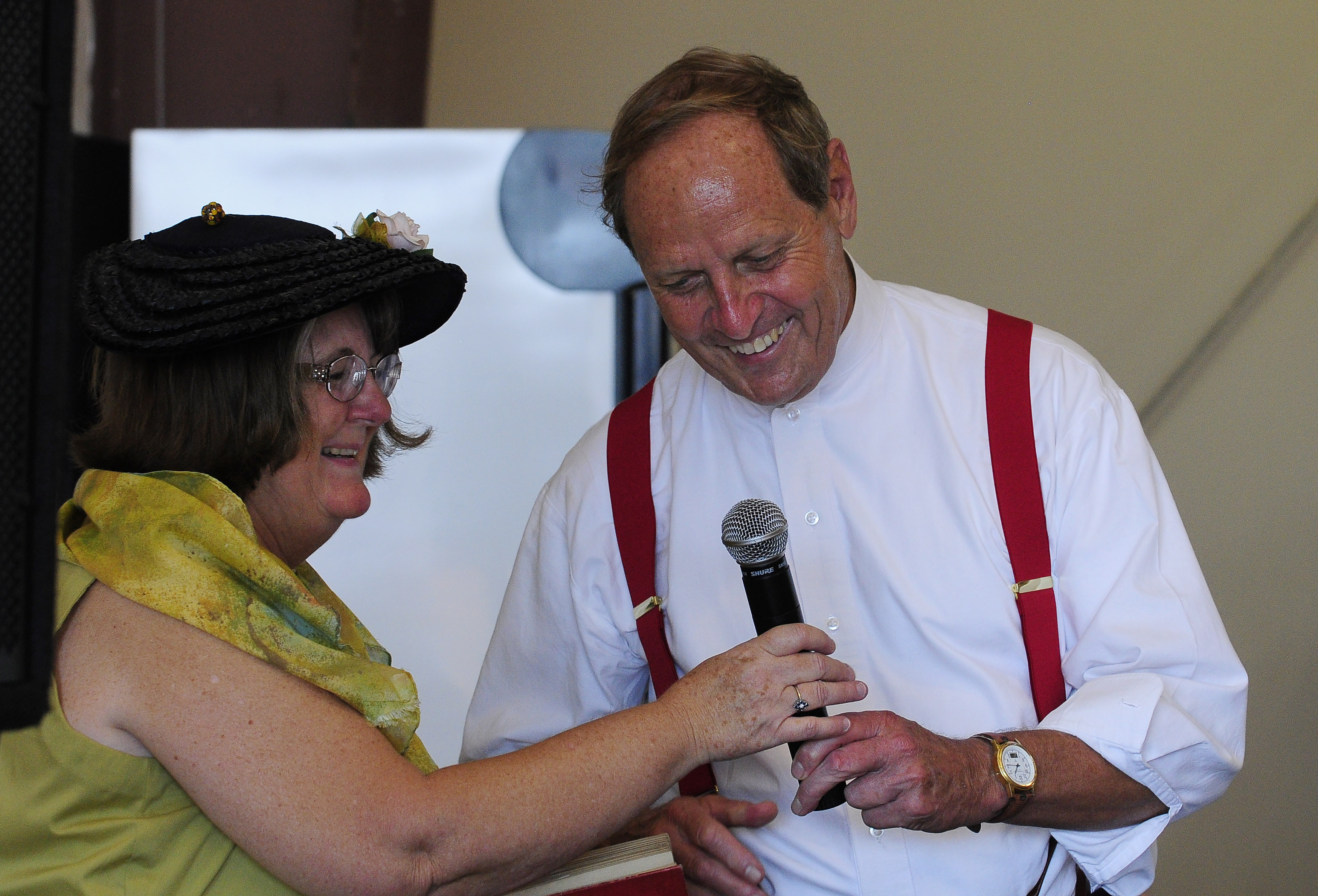 Wearing a Golden Age of aviation period costume, Peach State Aerodrome owner Ron Alexander is introduced at Candler Field Museum during the 2011 Vintage Day celebration in Williamson, Georgia. Alexander and a passenger died in a Jenny vintage airplane crash Nov. 17. Photo by David Tulis.