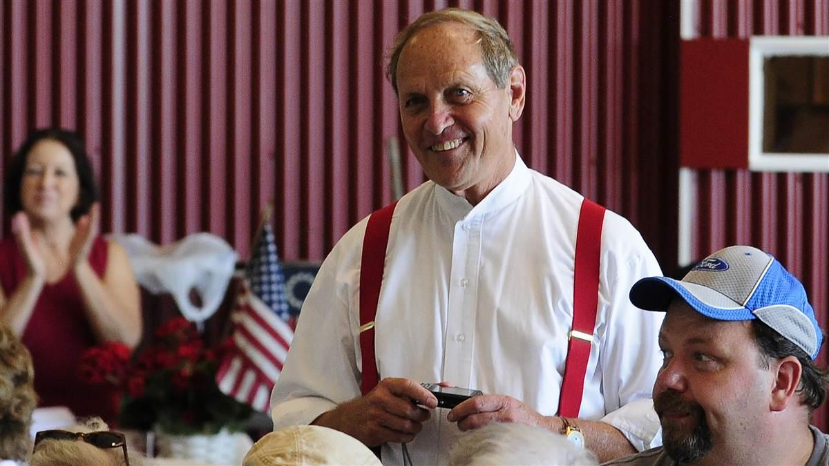 Wearing a Golden Age of aviation period costume, Peach State Aerodrome owner Ron Alexander is recognized at Candler Field Museum during the 2011 Vintage Day celebration in Williamson, Georgia. Alexander and a passenger died in a Jenny vintage airplane crash Nov. 17. Photo by David Tulis.