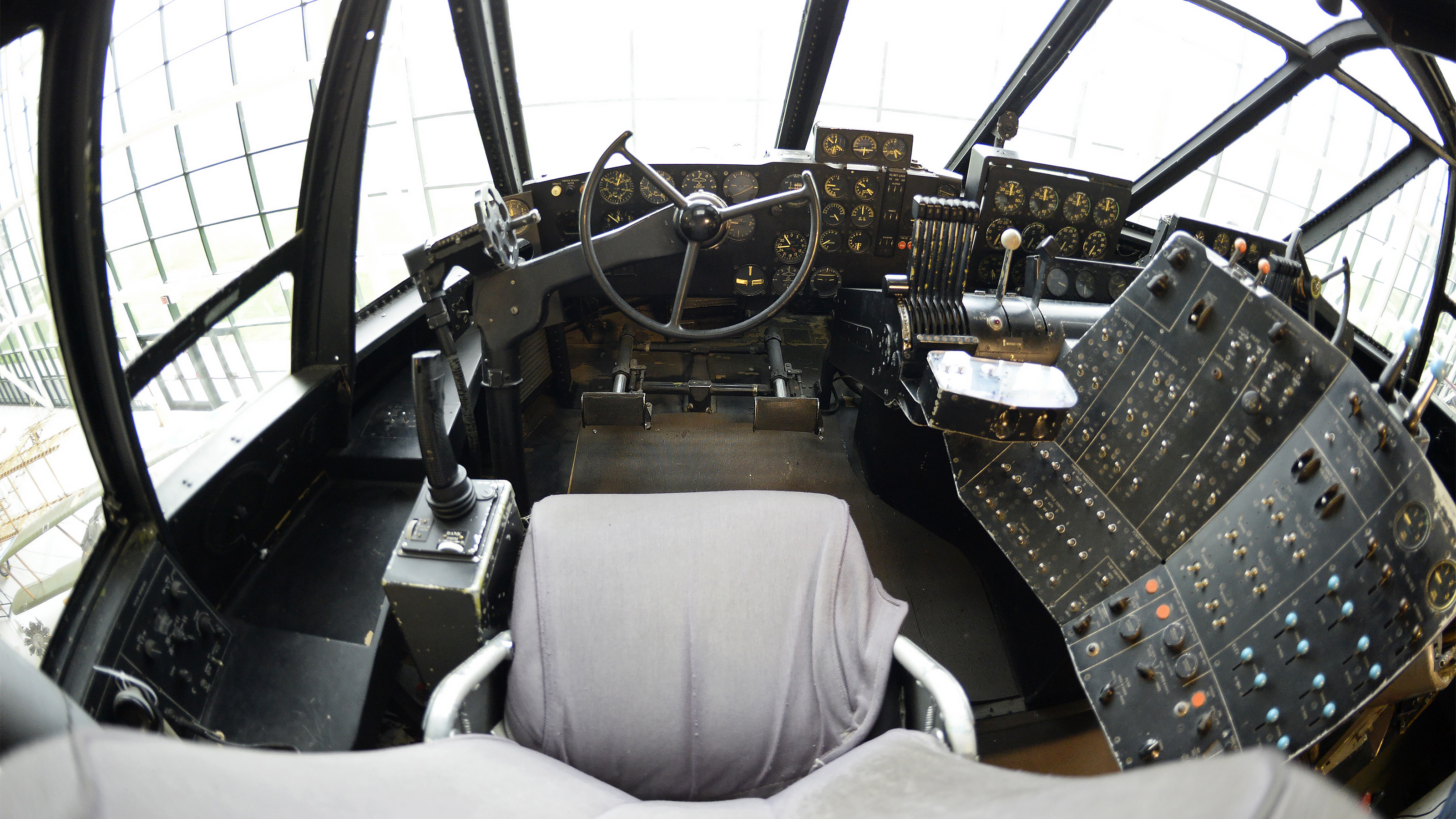 The view from Howard Hughes' H-4 Hercules cockpit is expansive, with four large windows, eight power levers, and hundreds of switches, dials, and gauges. Photo by David Tulis.