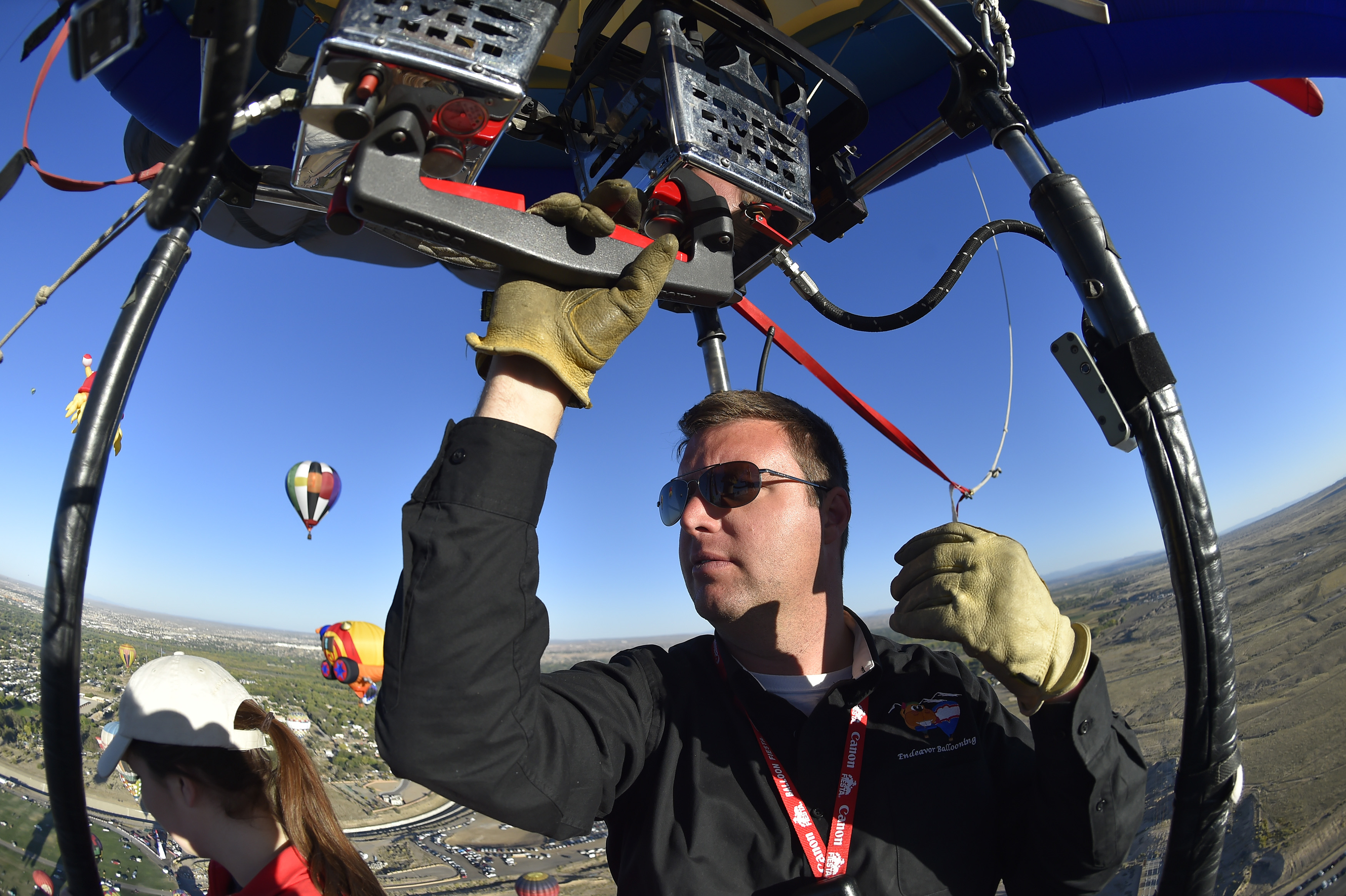 Pilot Colin Graham adds lift to his balloon during the 45th Albuquerque International Balloon Fiesta. Photo by David Tulis.