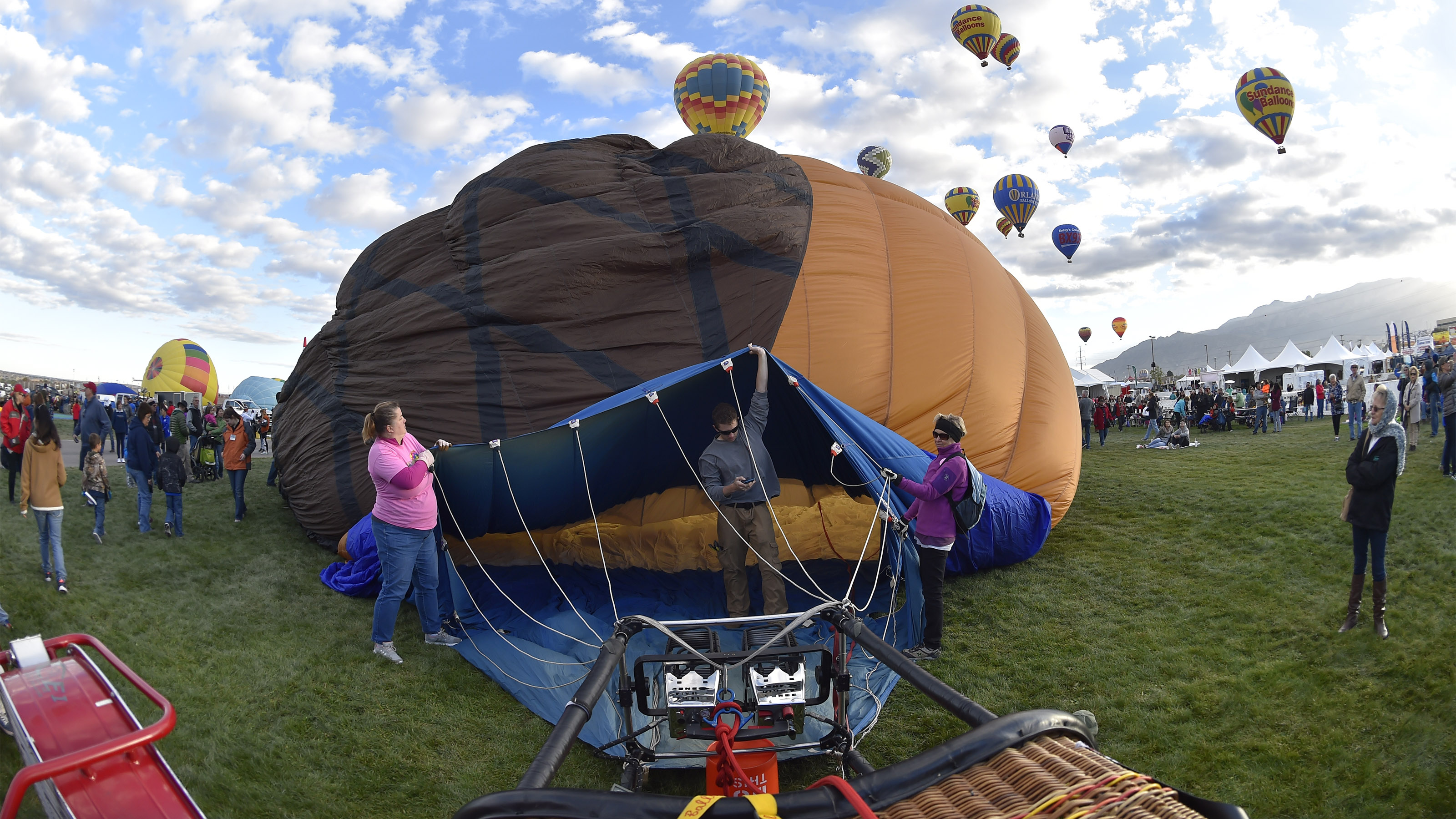 Ground crew members help inflate a balloon during the 45th Albuquerque International Balloon Fiesta in Albuquerque, New Mexico. Photo by David Tulis.