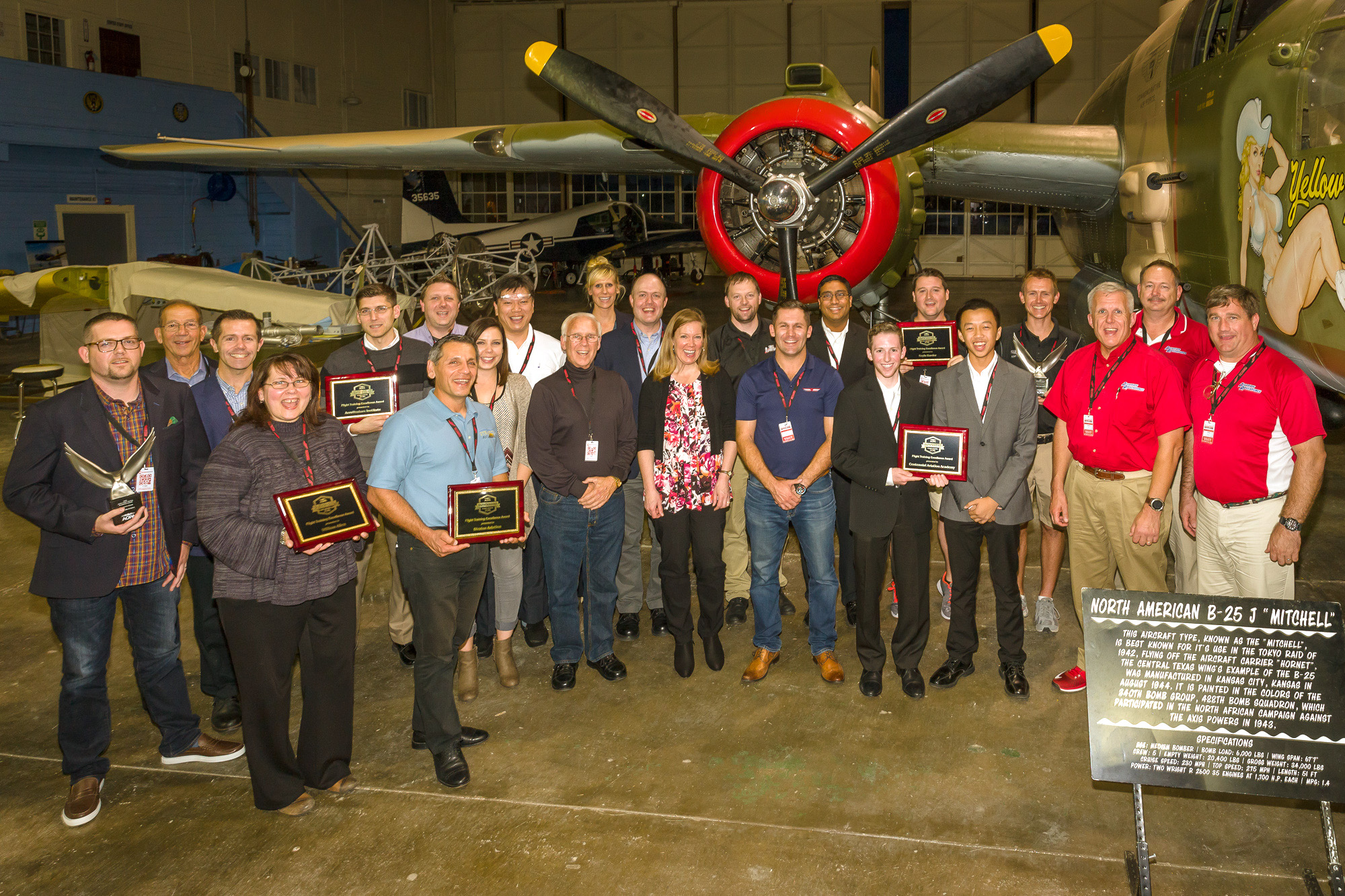 Winners of AOPA's 2016 Flight Training Excellence Awards gather for a group photo during Redbird Flight Simulation's annual Migration conference in San Marcos, Texas, Oct 25. Photo by Michael Hart.