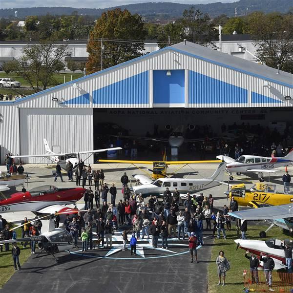 The inaugural Wings 'n Wheels aircraft, automobile, and motorcycle event that began as a gathering between friends drew almost 2,500 to AOPA's National Aviation Community Center at the Frederick Municipal Airport in Frederick, Maryland, Oct. 22. Photo by David Tulis.