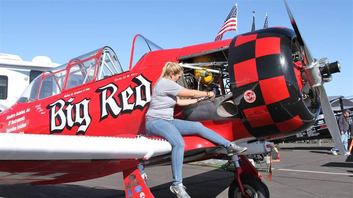 "Sanders Air Racing's T-6 Texan, Big Red, gets some TLC in the Reno pits. Jasper, Alabama-based Joey ""Gordo"" Sanders pilots the venerable racer. Photo by Robert Fisher."
