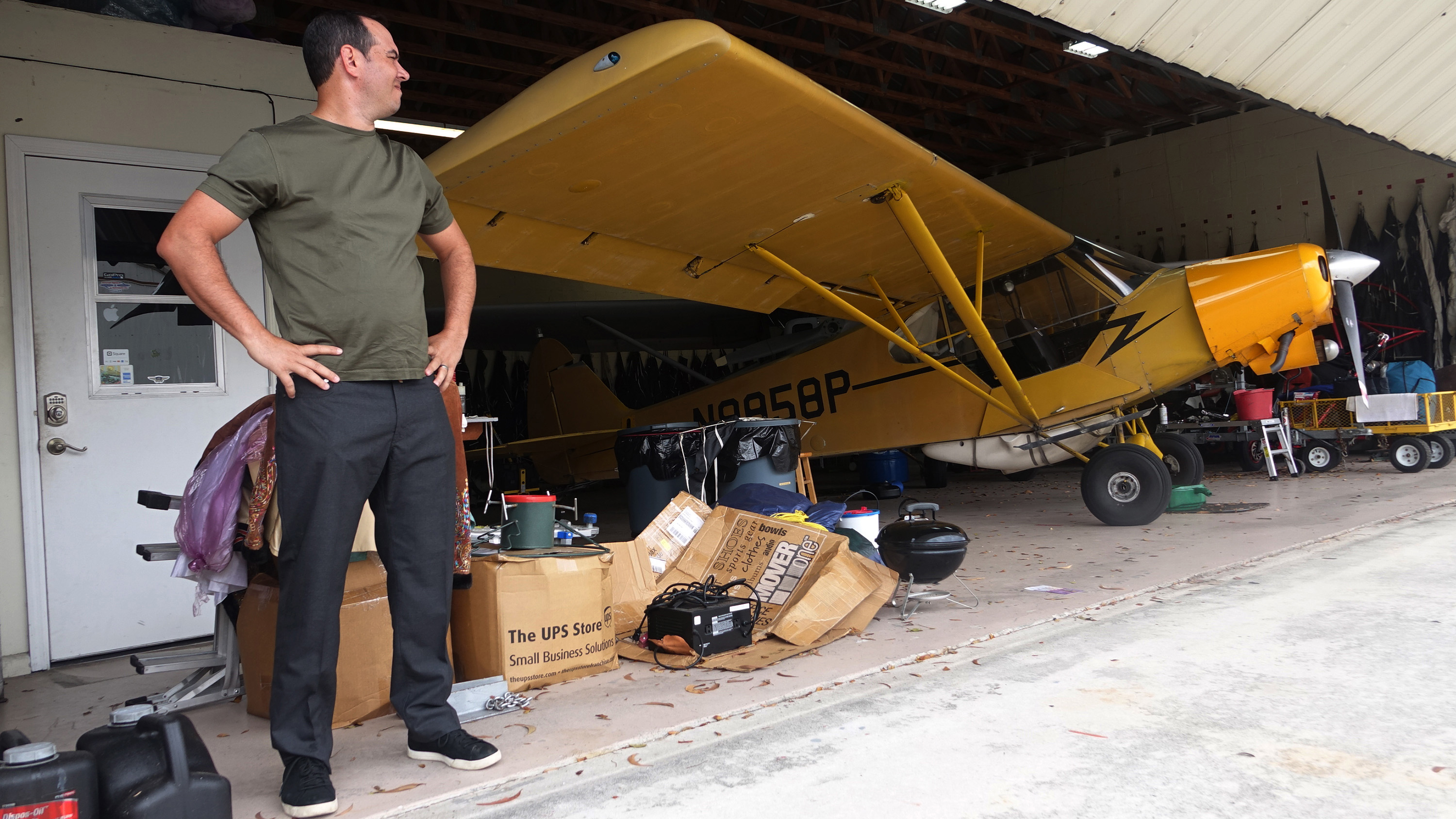 Jorge Gonzalez, of Skywords Advertising, is seen with his Piper Super Cub at the hangar he rents at Lantana Airport. Gonzalez said during a meeting with U.S. Rep. Lois Frankel that he might have to shutter his business if President Trump continues to visit Palm Beach and close the airspace on weekends. Courtesy of Joe Cavaretta, Fort Lauderdale Sun-Sentinel.