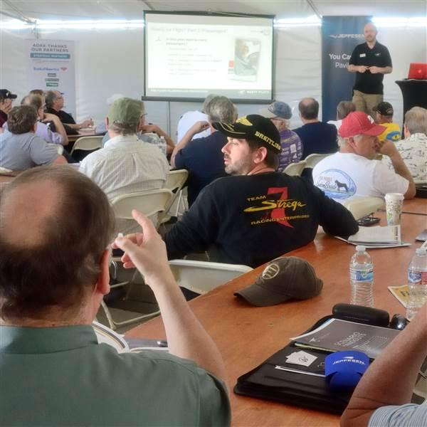 Chris Moser, with AOPA's You Can Fly initiative, poses a question to participants during the Rusty Pilots seminar Saturday morning. About 80 rusty pilots signed up for the seminar; another 80 completed it on Friday afternoon. Photo by Mike Collins.