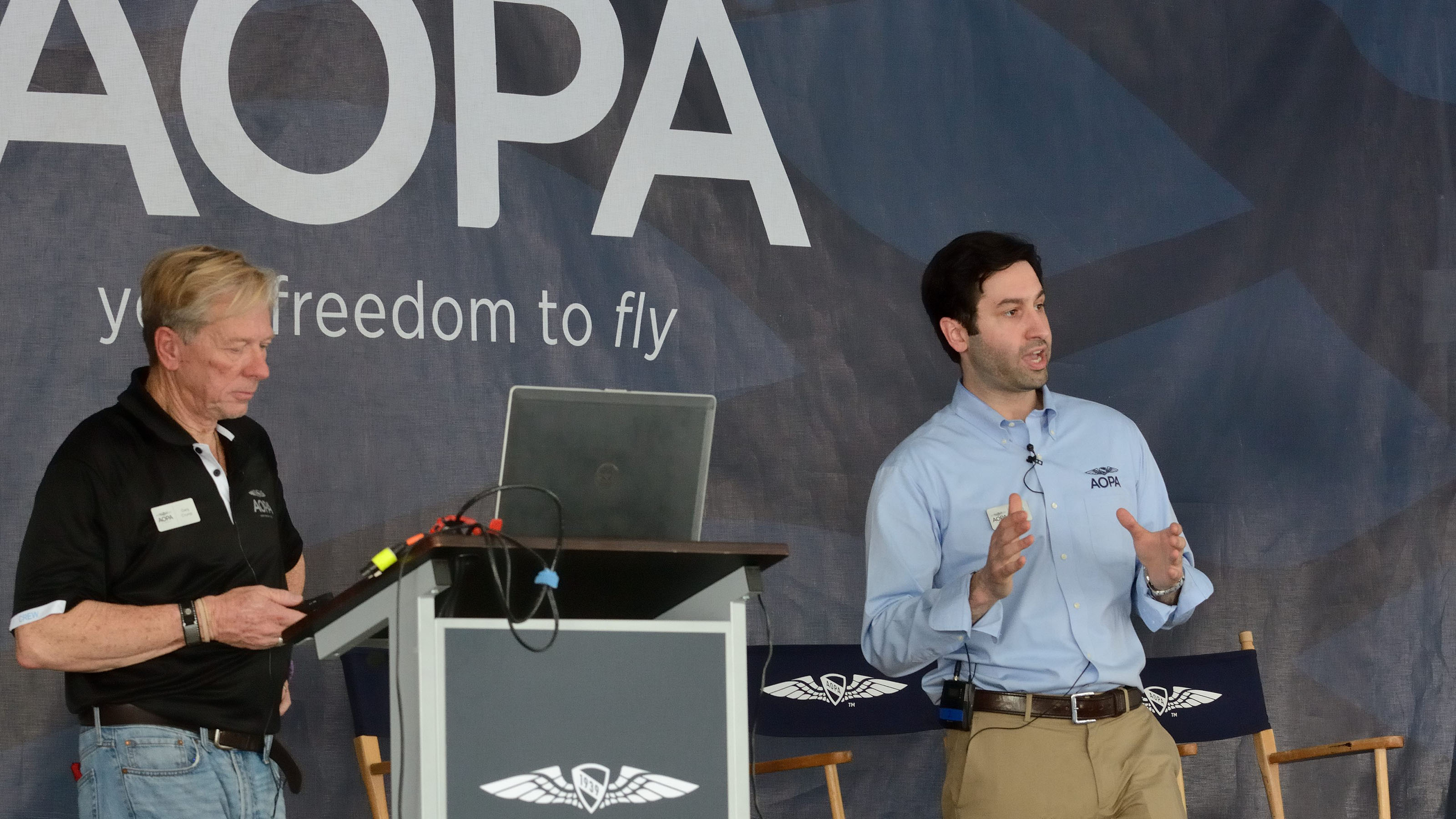 Gary Crump, left, AOPA's director of medical certification, and Jared Allen--an attorney for the AOPA Legal Services Plan--discuss the new BasicMed rules at Sun 'n Fun 2017. Photo by Mike Collins.