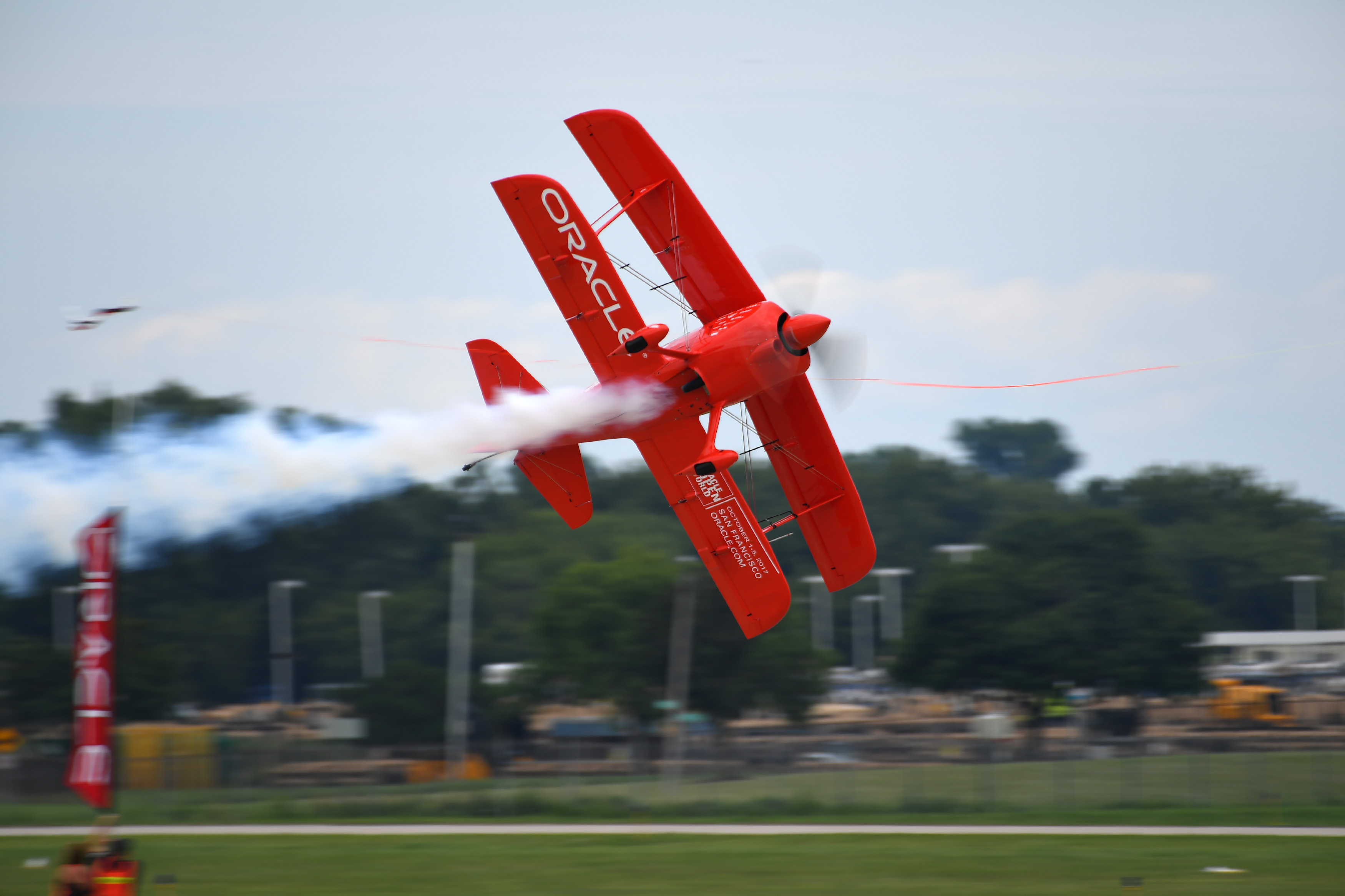 Sean D. Tucker performs his signature triple ribbon cut during EAA AirVenture at Wittman Regional Airport in Oshkosh, Wisconsin. Photo by David Tulis.