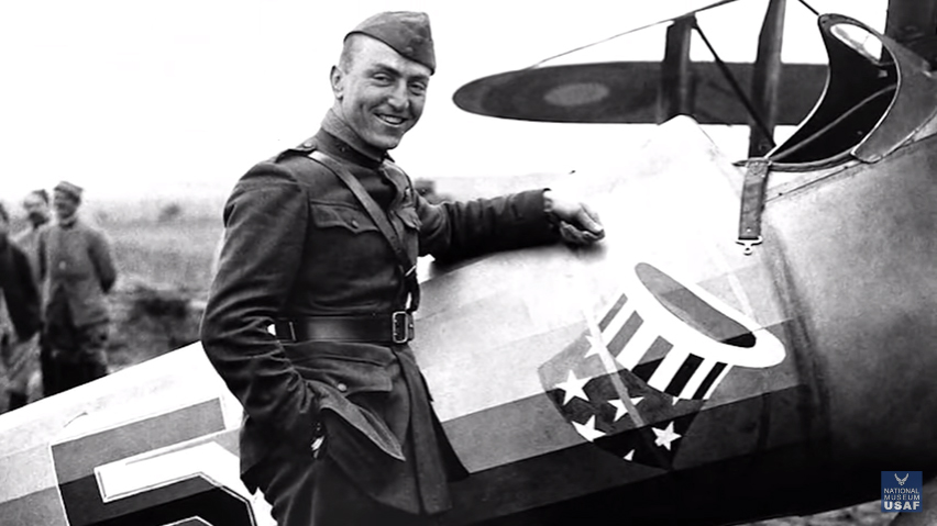 Captain Eddie Rickenbacker poses with an aircraft bearing the emblem of the 94th Aero Squadron. Image courtesy of the National Museum of the U.S. Air Force via Youtube.