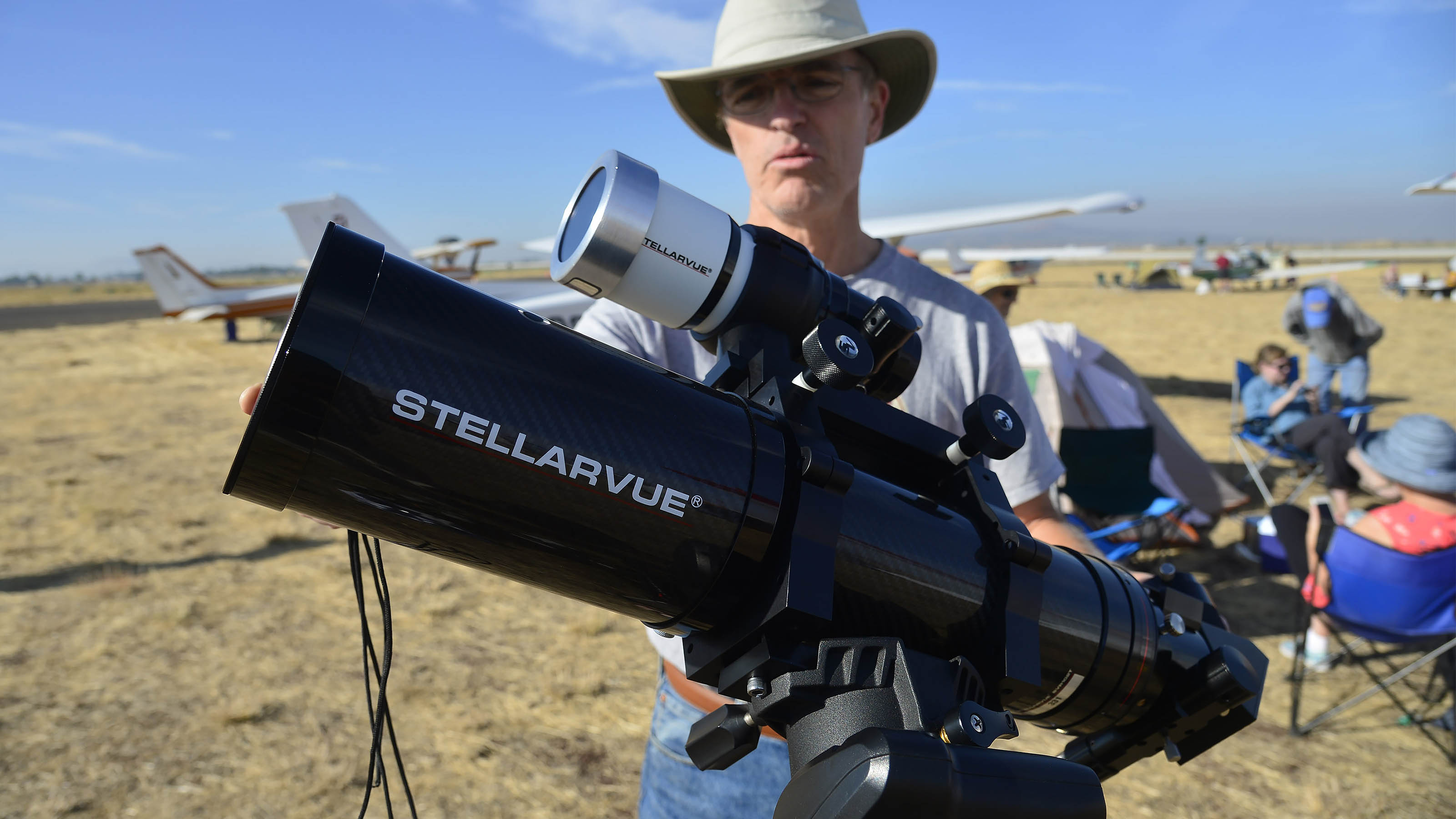 Amateur astronomer and Cessna 182 pilot Chris Newton prepares a Stellarvue telescope that he will use during the total solar eclipse at Madras Municipal Airport in Madras, Oregon. Photo by David Tulis.