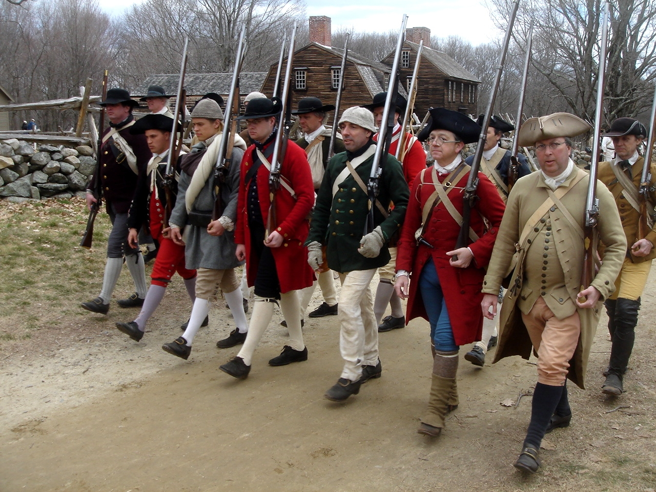 "At Minute Man National Historical Park, the opening battle of the Revolution is brought to life as visitors explore the battlefields and structures associated with April 19, 1775, and witness the American revolutionary spirit through the writings of the Concord authors. Here, ""Minute Men"" march in a reenactment of the Revolutionary War's first battle, performed each April.  Photo courtesy NPS."