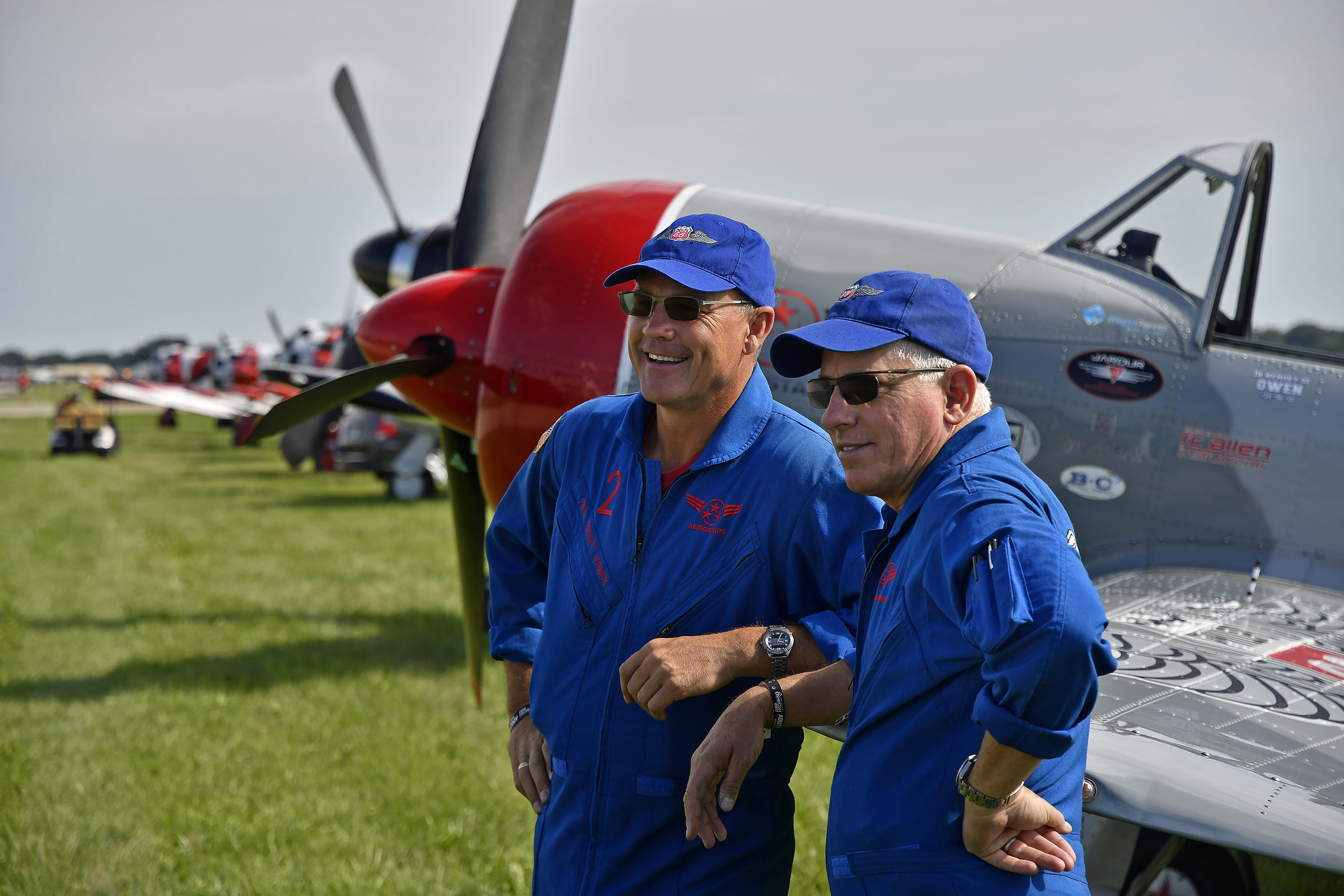 Phillips 66 Aerostars teammates Paul 'Rocket' Hornick and Dave 'Cupid' Monroe smile from the flight line during EAA AirVenture in Oshkosh, Wisconsin. The pilots begin training for the summer air show season in January. Photo by David Tulis.