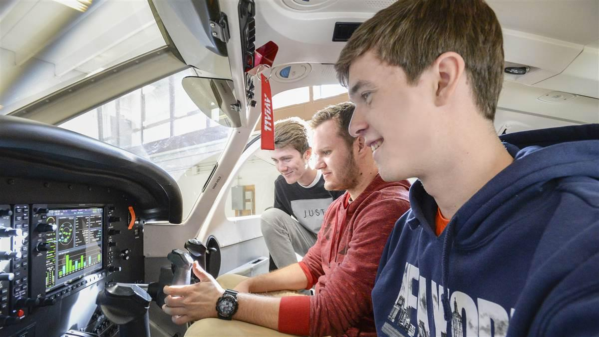 University of North Dakota students Body Graff, Luke Schurtz, and Max Lambrecht inspect the panel of a Piper Archer II training aircraft. Photo courtesy of Jackie Lorentz, University of North Dakota.