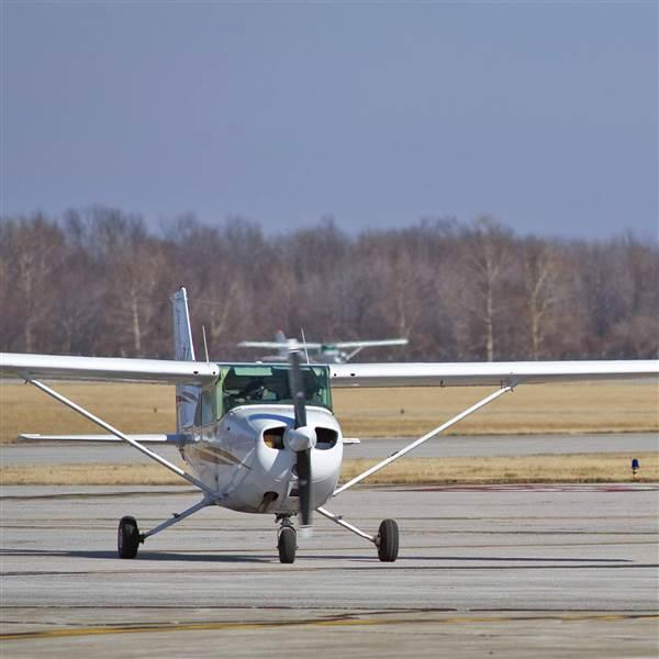 Cessna Skyhawks taxi to the Southern Illinois University Carbondale flight line after landing at Southern Illinois Airport in Carbondale/Murphysboro, Illinois. Donations from alumni are helping to equip the university's fleet with ADS-B equipment in advance of the FAA mandate. Photo courtesy of Southern Illinois University.