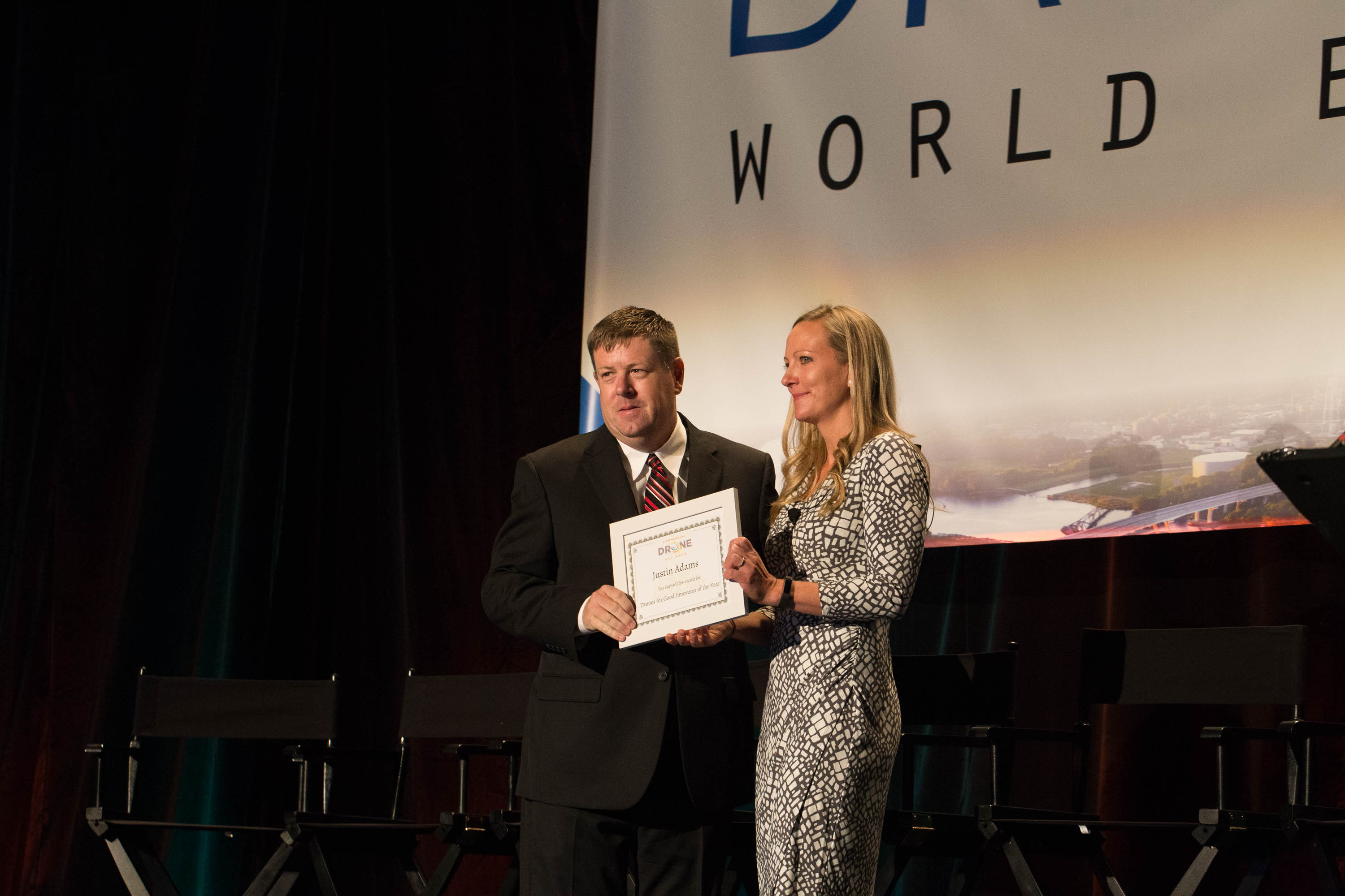 Justin Adams accepts the Drones for Good Innovator of the Year award from the Commercial Drone Alliance at Drone World Expo in San Jose, California, Oct. 4. He headed straight to Puerto Rico after the conference to fly damage surveys following Hurricane Maria. Jim Moore photo.