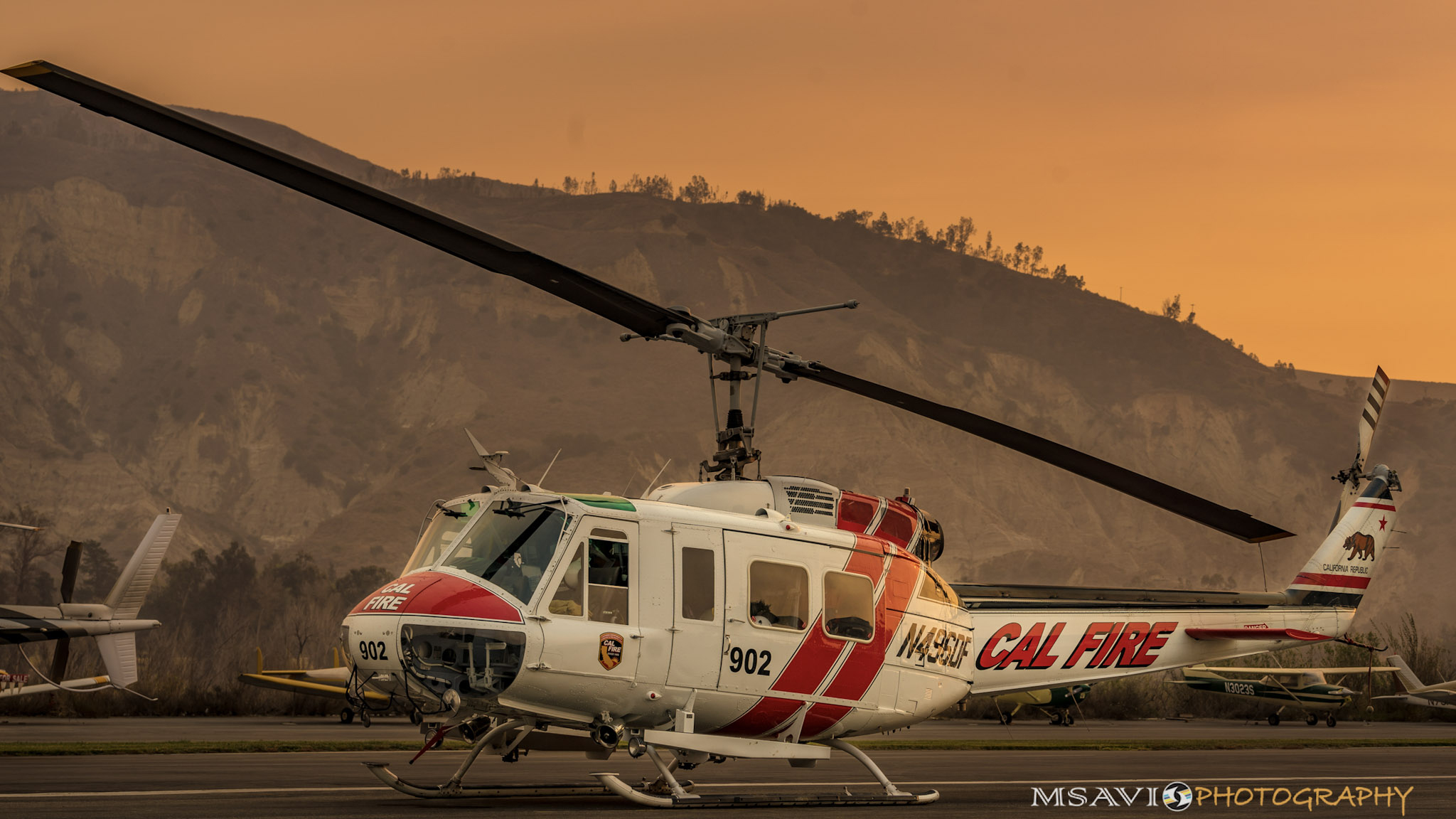 Smoke descends near a Cal Fire helicopter during firefighting operations based at California's Santa Paula Airport. Photo by Mike Salas, MSAVI Photography and Focal Flight.