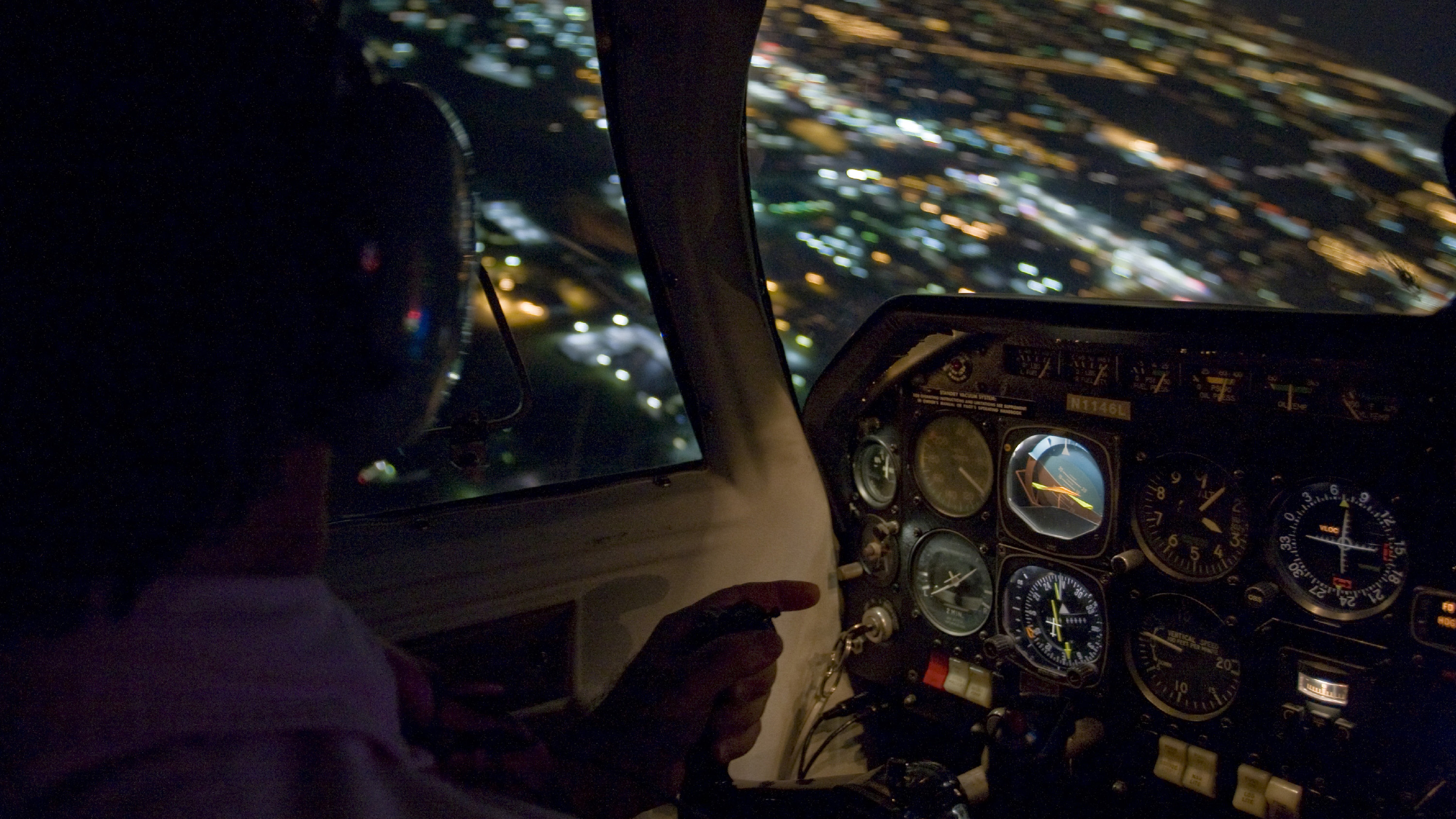 In flight night cockpit photography of a pilot turning over Jabara Airport on the east side of Wichita, KS.