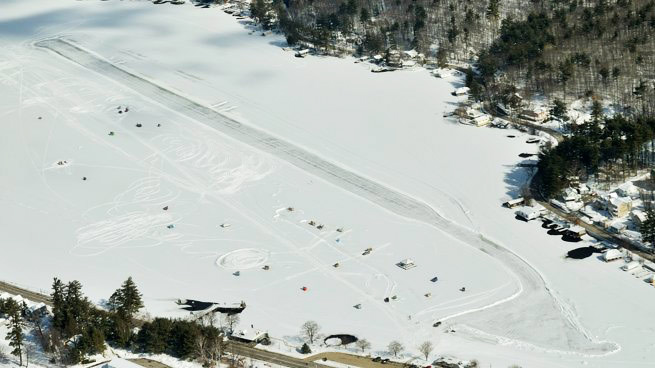 The Alton Bay Ice Airport looks different than it appears in this image from a few years ago; volunteers have expanded the aircraft parking area—and now plow a parallel taxiway. Photo by Mike Collins.