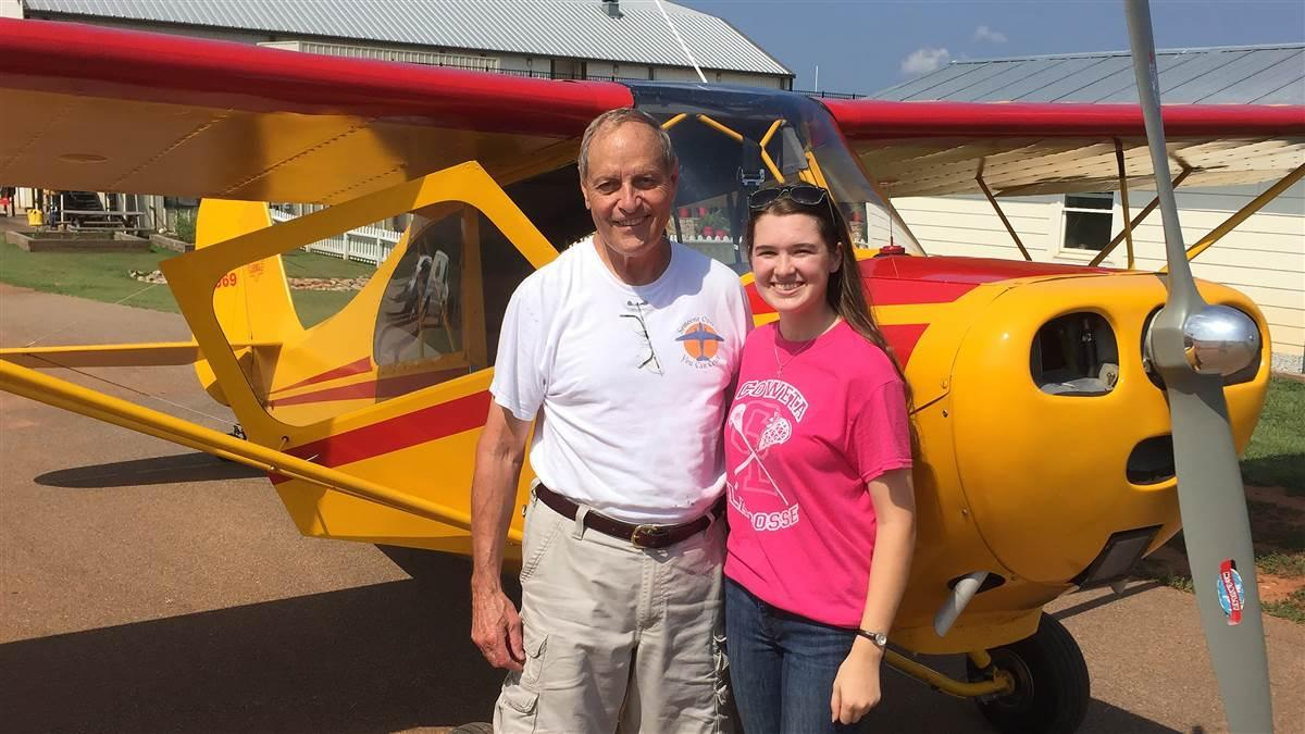 Student pilot Cayla McLeod is honoring her instructor and mentor Ron Alexander with aviation inspired wristbands that help celebrate his life. Photo courtesy of Cayla McLeod.