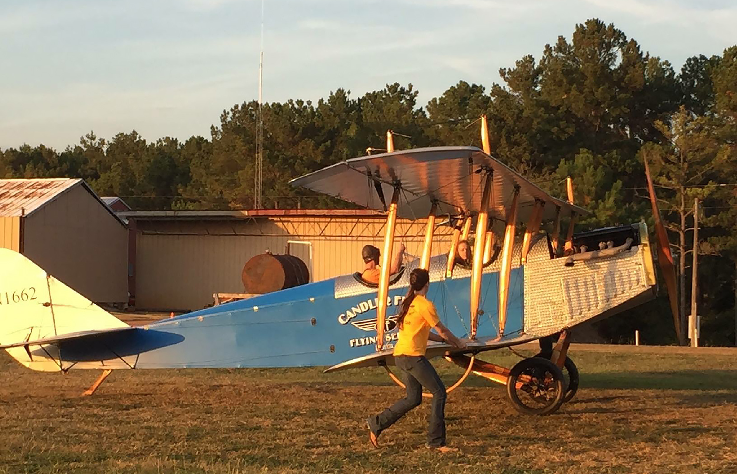 Student pilot Cayla McLeod helps wing walk a Curtiss JN-4 Jenny for Ron Alexander at his Peach State Aerodrome in Williamson, Georgia. Photo courtesy of Cayla McLeod.