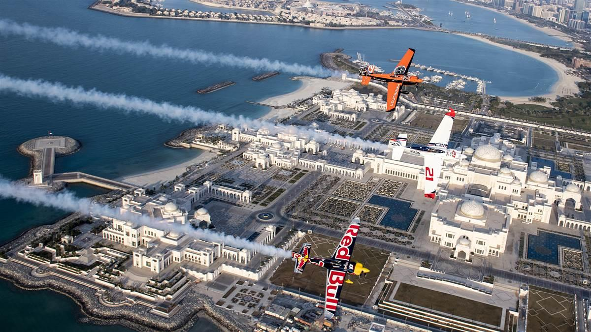 Defending Red Bull Air Race World Champion Matthias Dolderer of Germany leads fellow pilots Nicolas Ivanoff of France and Martin Sonka of the Czech Republic on a pre-race flight over the new 160,000-square-meter Presidential Palace in Abu Dhabi, United Arab Emirates, Feb. 6. Photo by Predrag Vuckovic/Red Bull Content Pool.