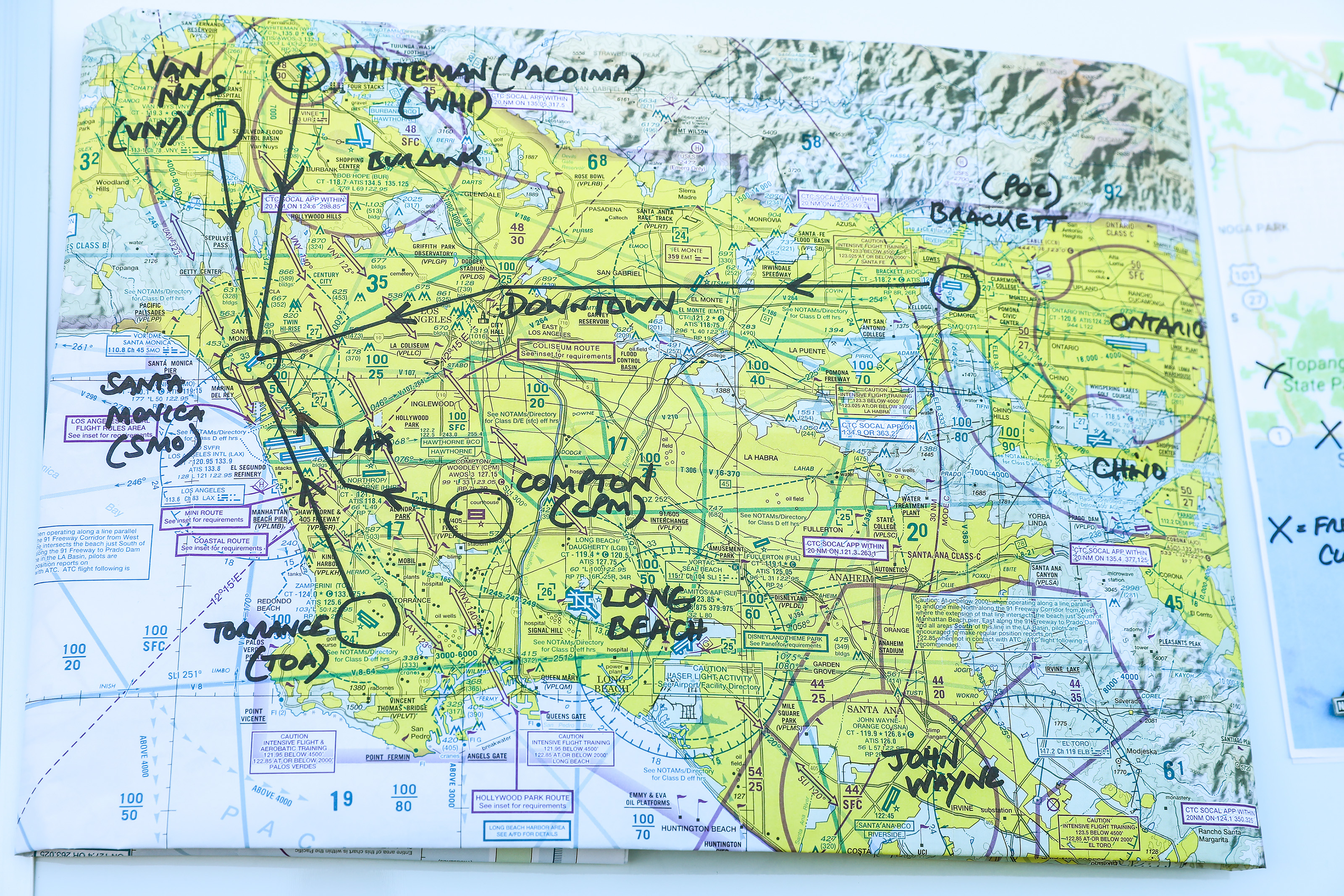The Disaster Airlift Response Team maps out its strategy for providing air transportation in the event of a natural disaster that takes out the Los Angeles regional freeway system. Photo by Roxanne Schorbach at Schorbach.com.