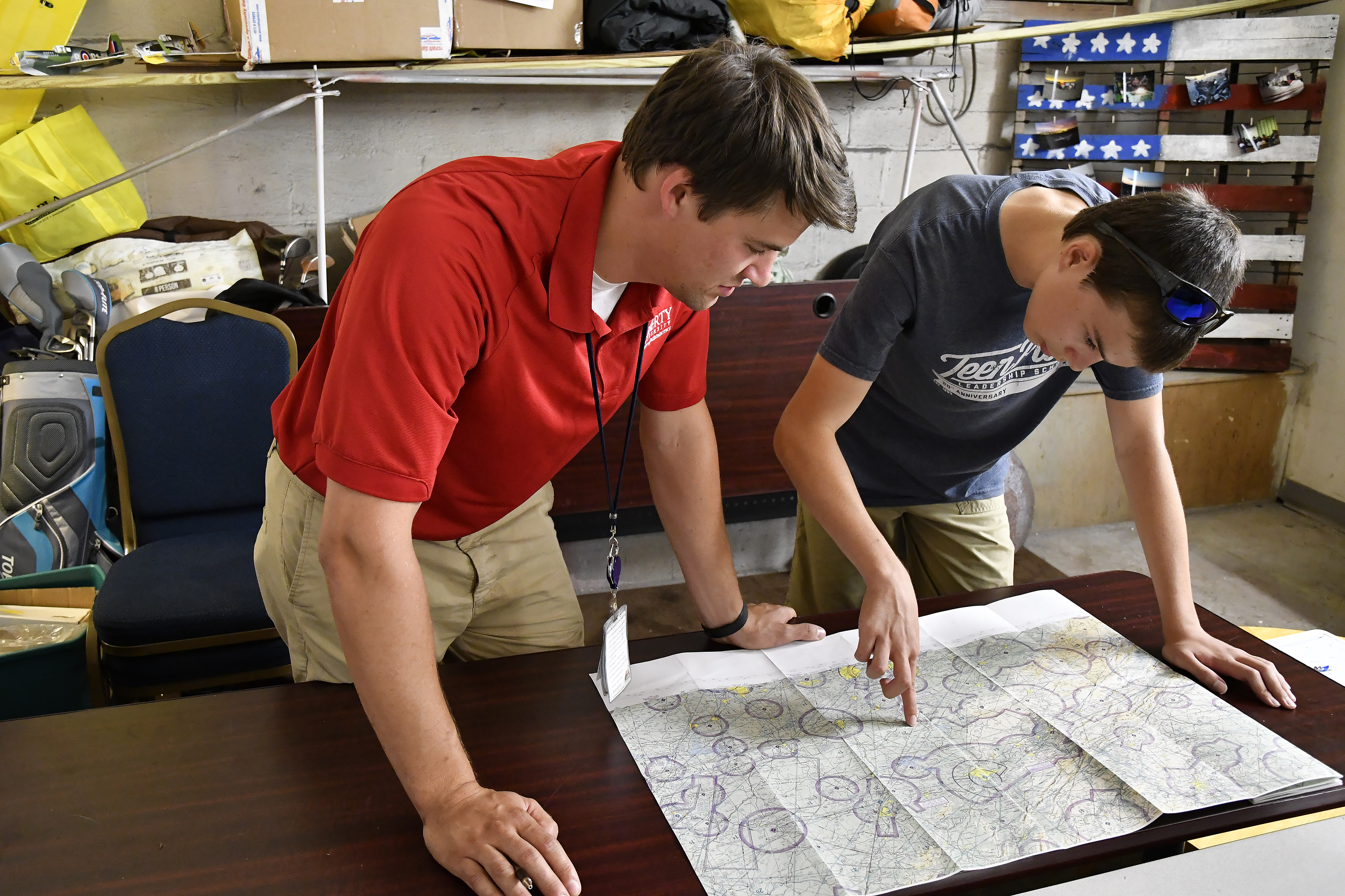 Instructor John Adams coaches student Timothy Cashman on chart skills at an informal New London Airport classroom in Lynchburg, Virginia. Photo by David Tulis.