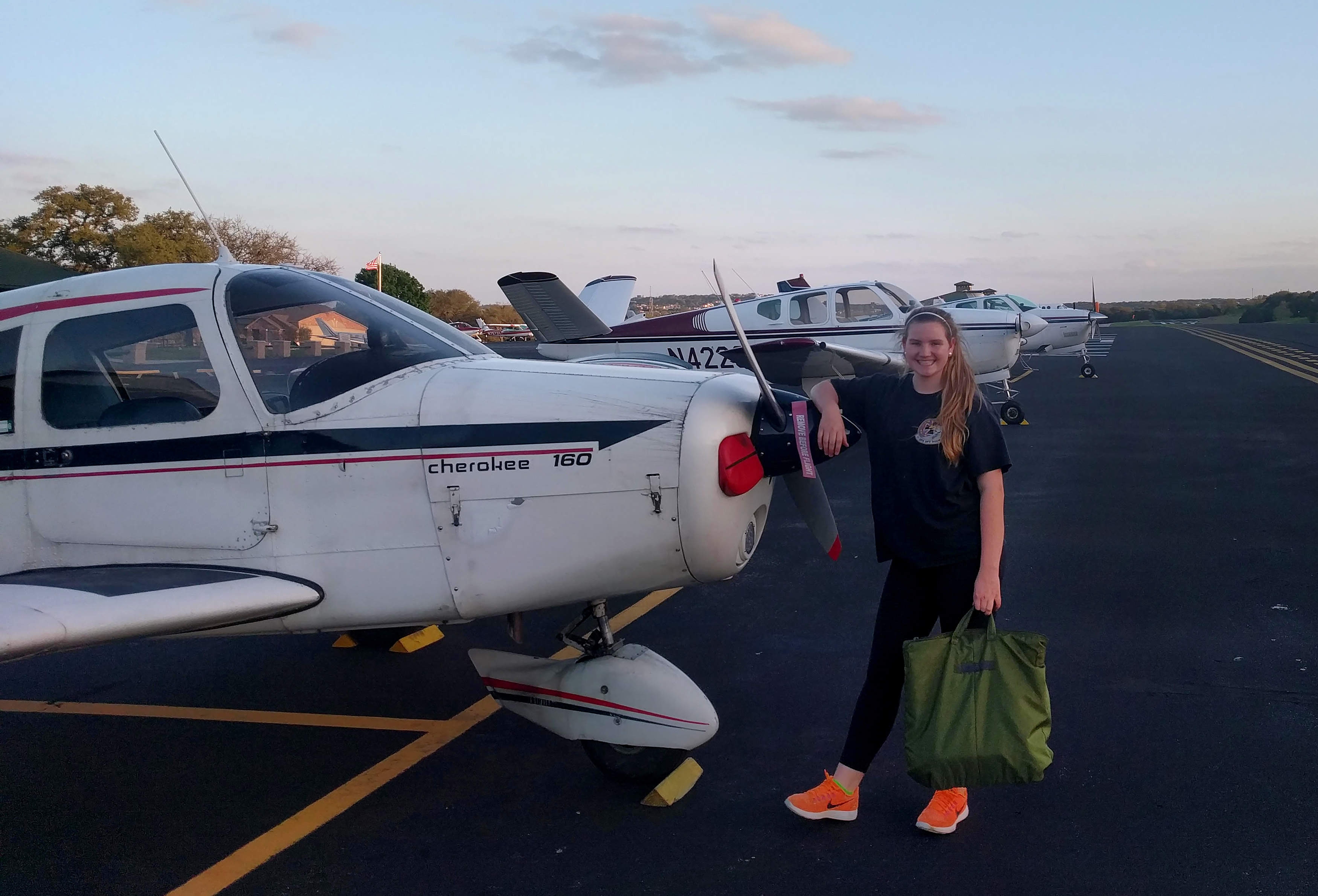 Student pilot Lauryn Spinetta with the Piper Cherokee PA-28 160 she is using for flight training. Photo courtesy of Lauryn Spinetta.