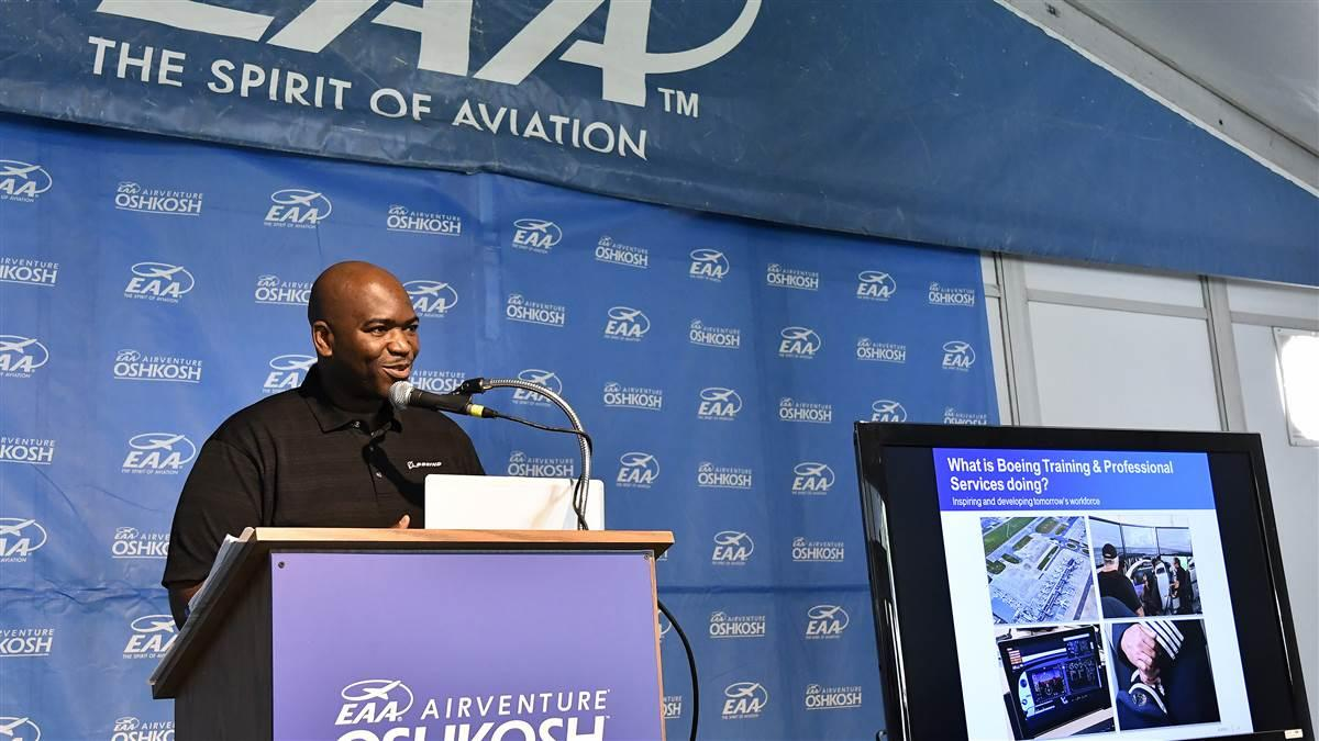 Boeing's William Ampofo releases the manufacturer's 2017-2036 aviation jobs forecast during EAA AirVenture in Oshkosh, Wisconsin, July 24. Photo by David Tulis.