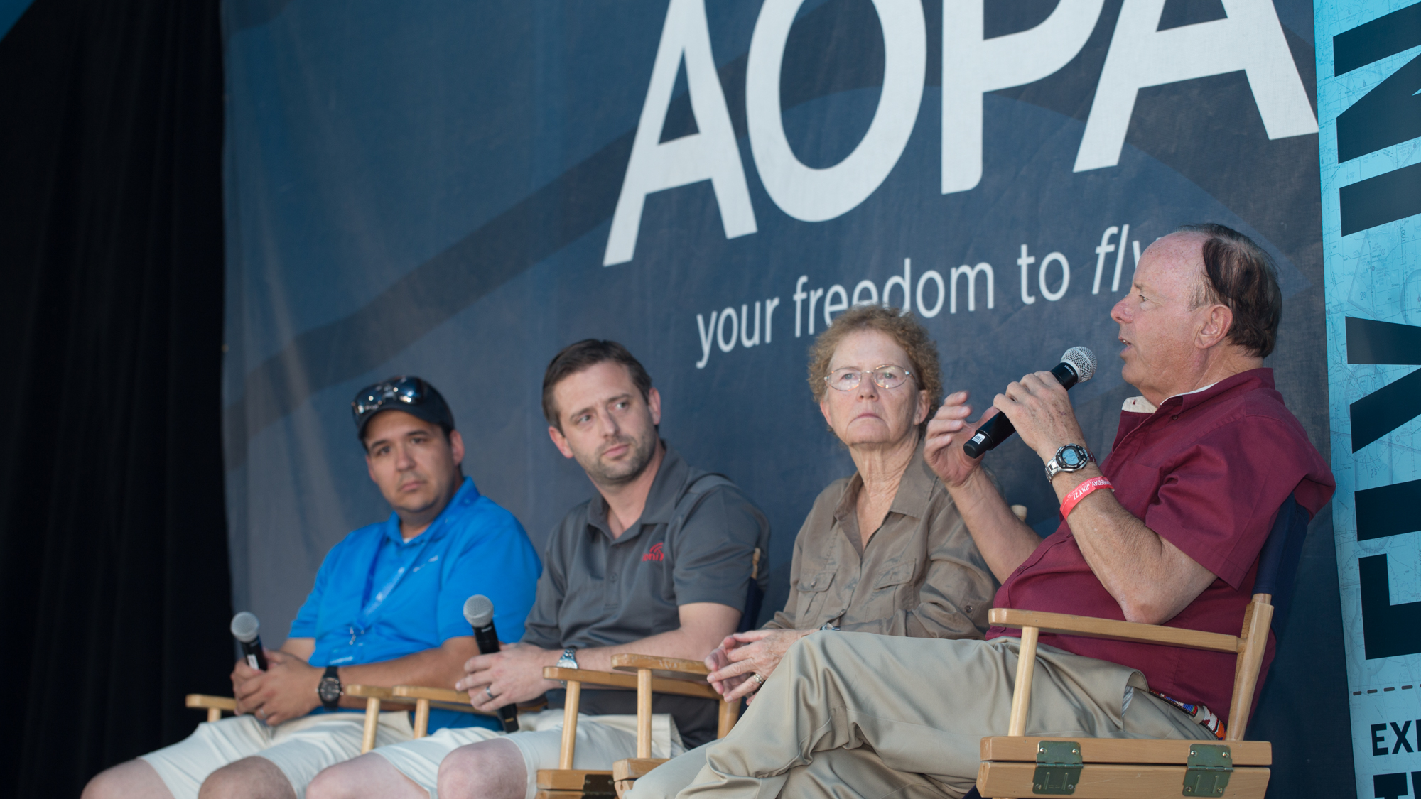King Schools co-founder John King, right, speaks during the AOPA Drone Social at EAA AirVenture July 27. Fellow panelists include his wife and King Schools co-founder Martha King, Ryan Braun of uAvionix (center), and Colin Romberger of DARTdrones (left). Jim Moore photo.
